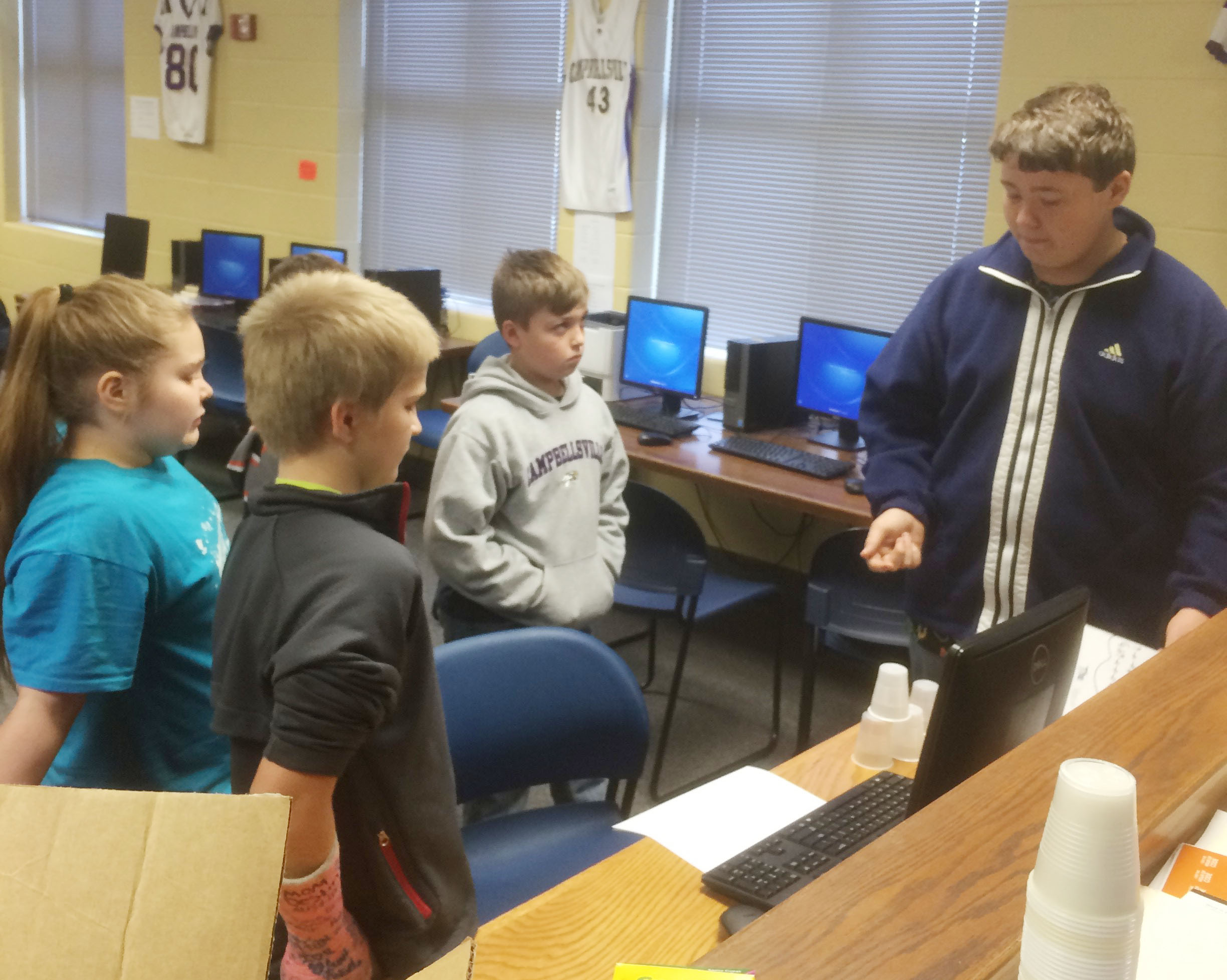 CHS freshman Conner Riley teaches CMS fourth-graders about computer coding.