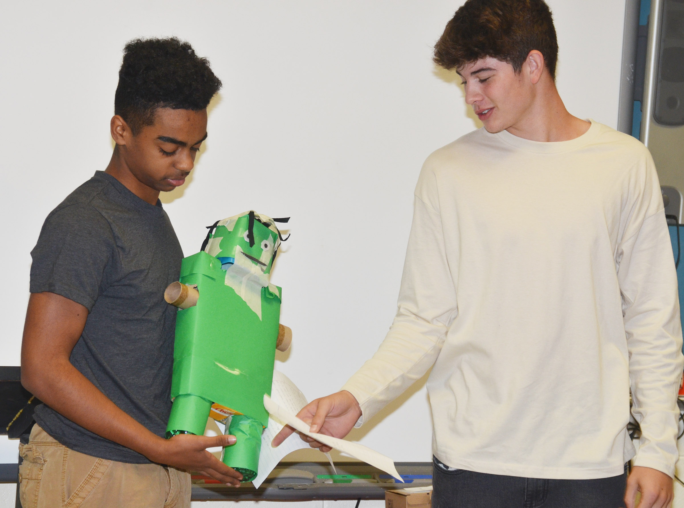 CHS juniors Davon Cecil, at left, and Mark Rigsby talk about their monster.