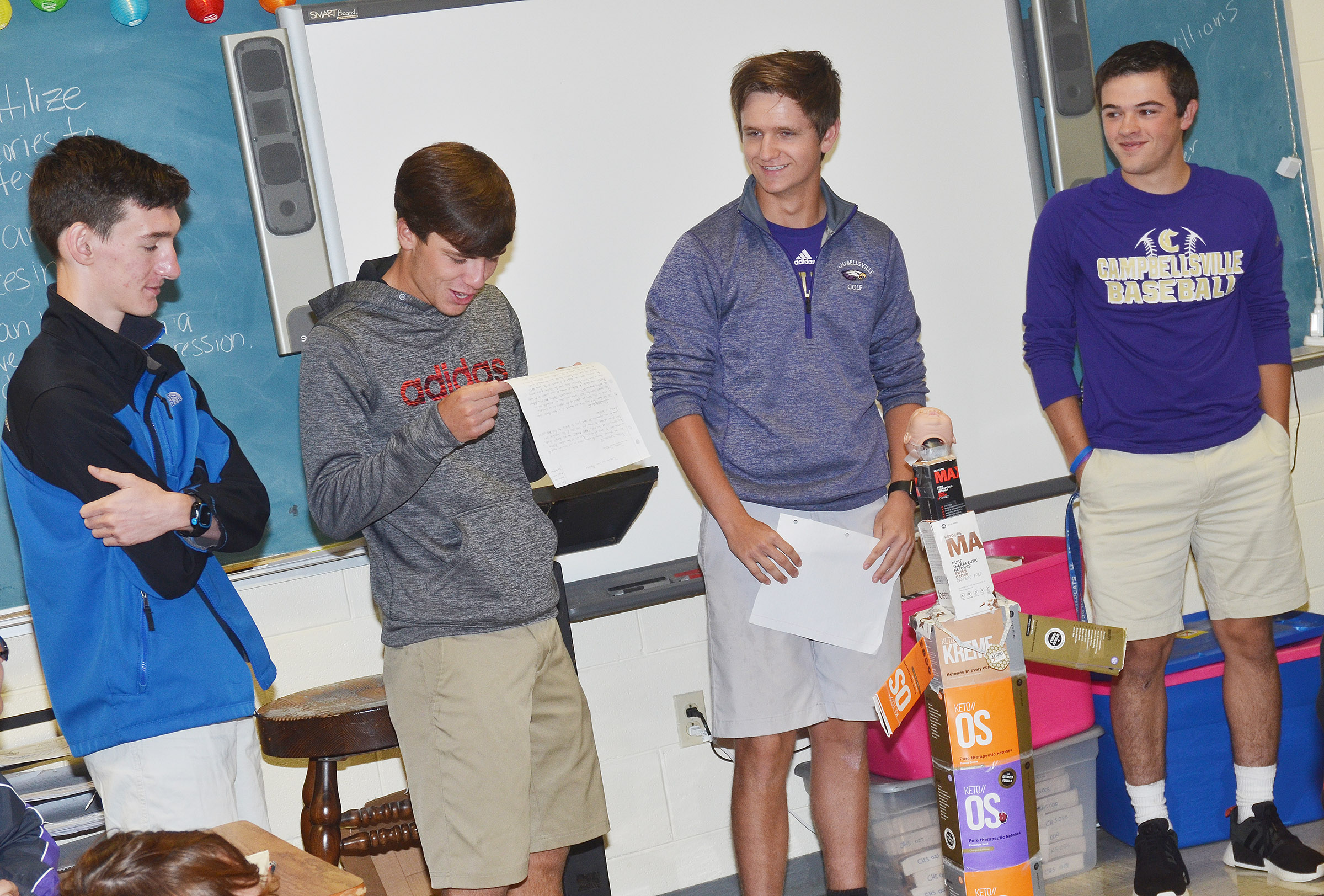 CHS juniors, from left, Ian McAcninch, Layton Hord, Myles Murrell and Ryan Kearney present their monster to their classmates.