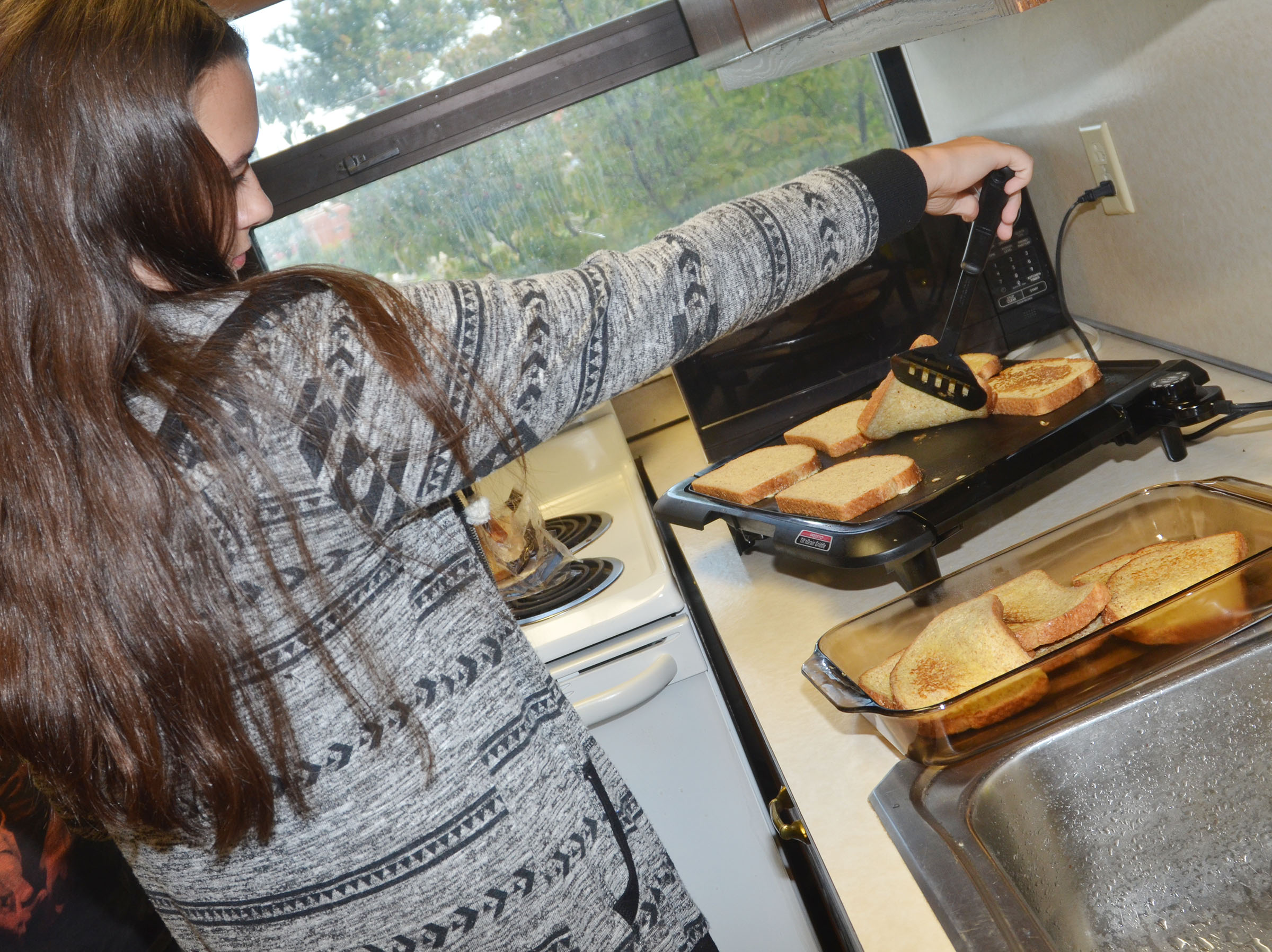 CHS junior Makala Antle flips the French toast.