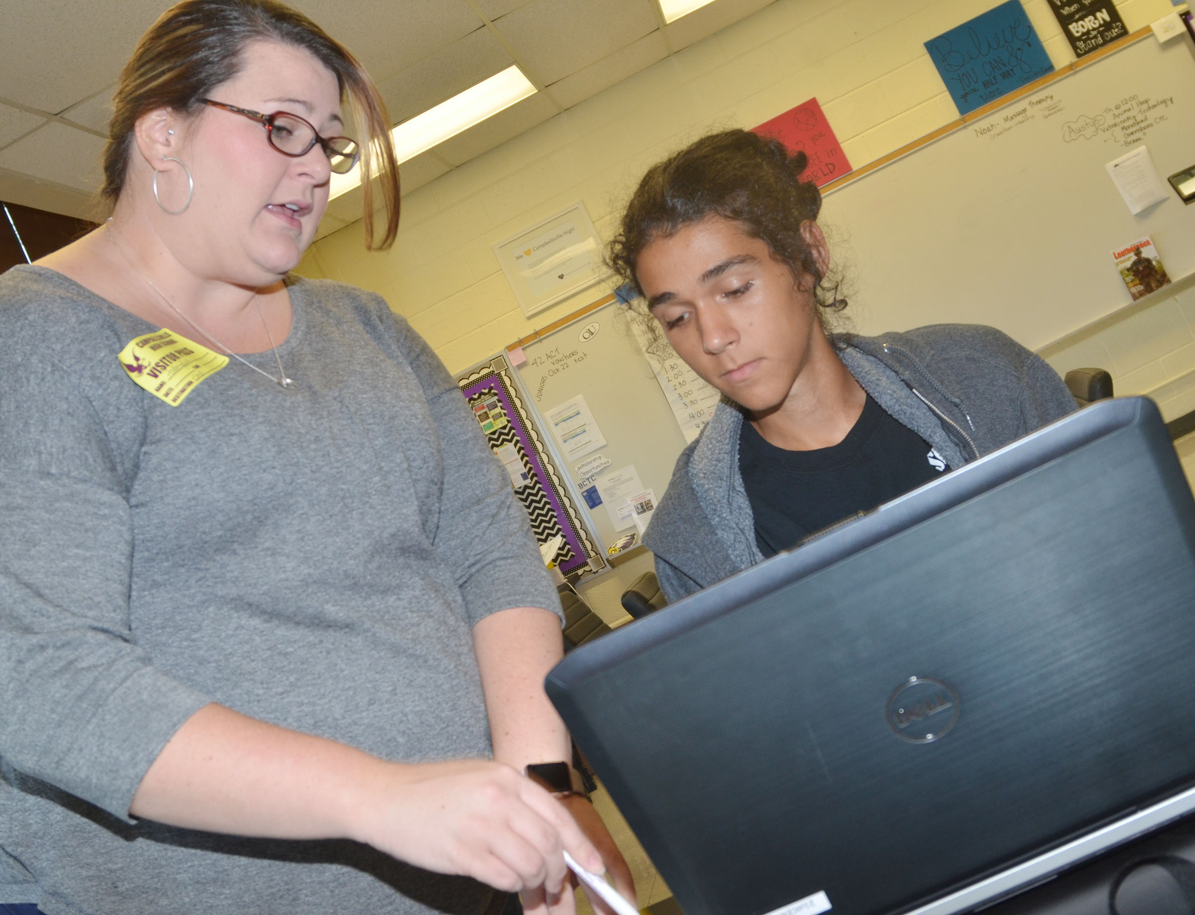 KHEAA representative Audrey Price helps CHS senior Michael De Oliveira register for a FSA ID account.