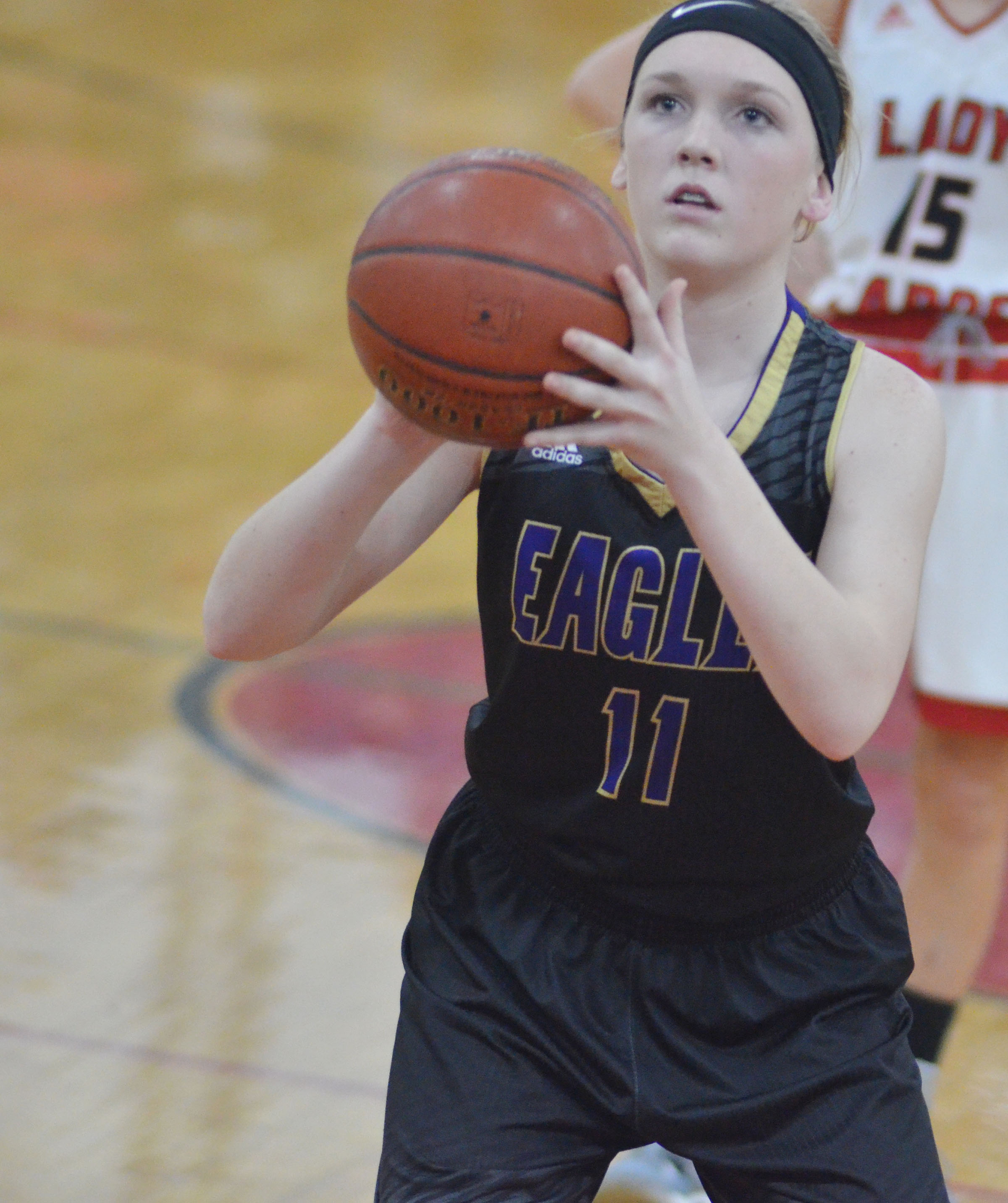 Campbellsville Middle School eighth-grader Catlyn Clausen shoots the ball.