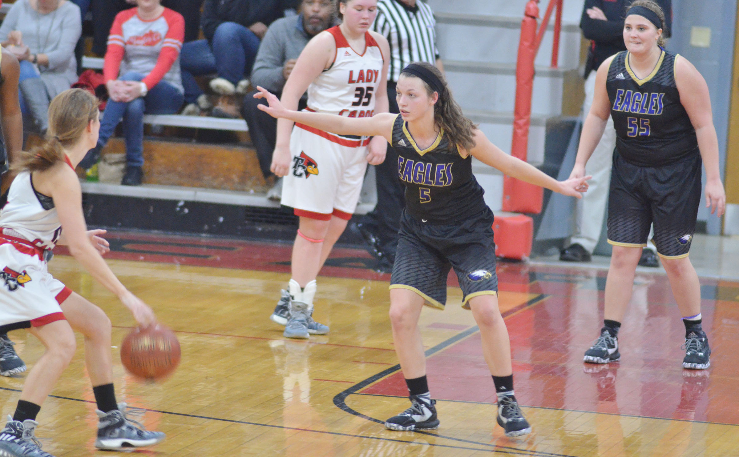 CHS seniors Caylie Blair, in front, and Brenna Wethington play defense.