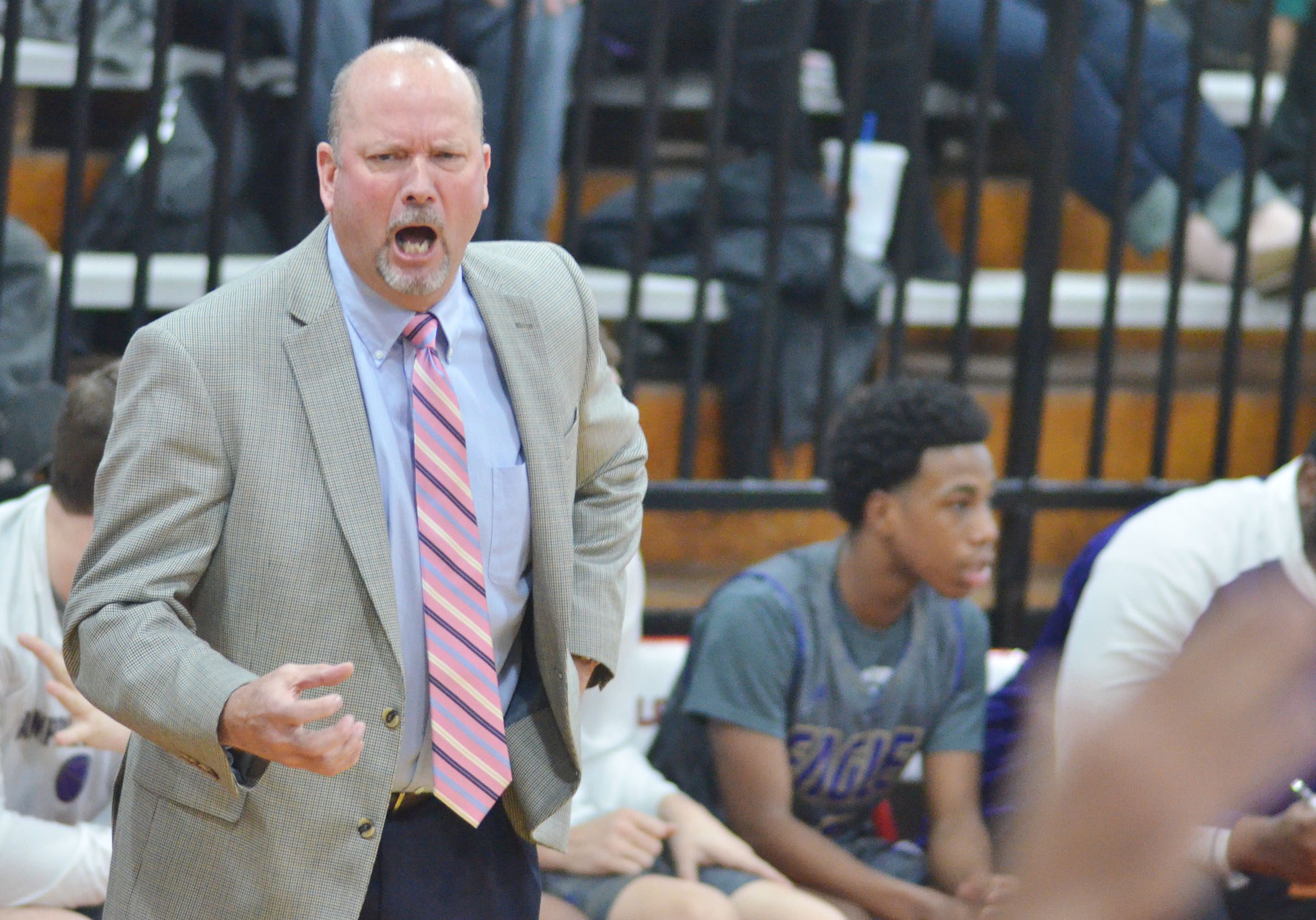 CHS boys' head basketball coach Tim Davis questions a call.