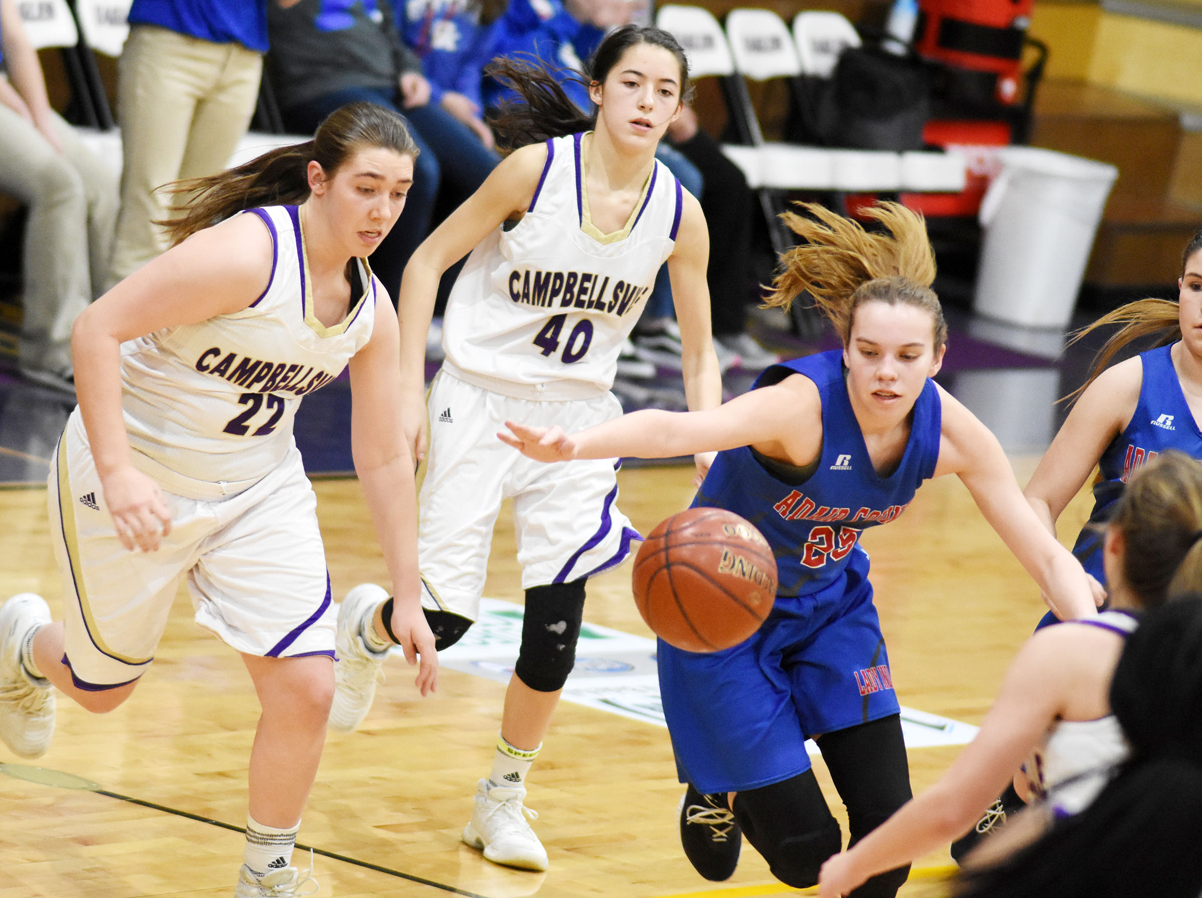 CHS freshman Abi Wiedewitsch, at left, and Campbellsville Middle School eighth-grader Kaylyn Smith battle for the ball.