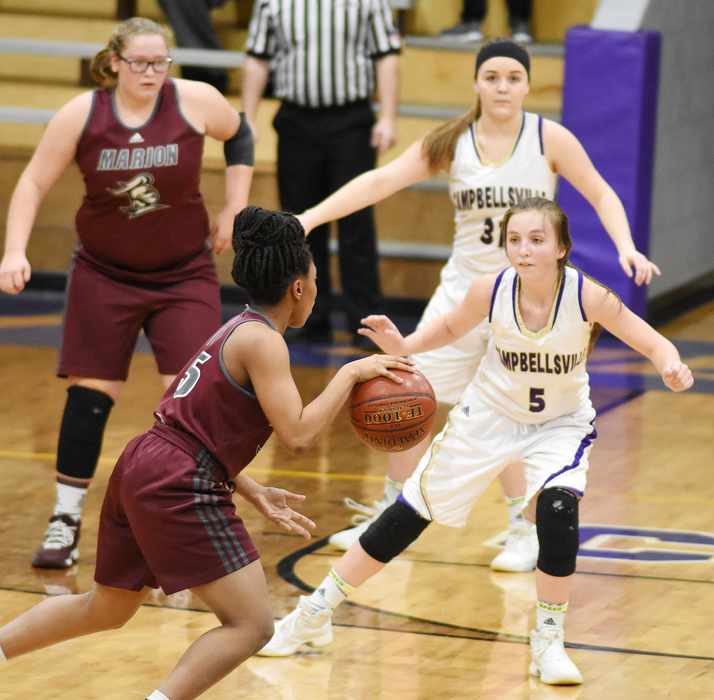 Campbellsville Middle School eighth-grader Lainey Watson plays defense.
