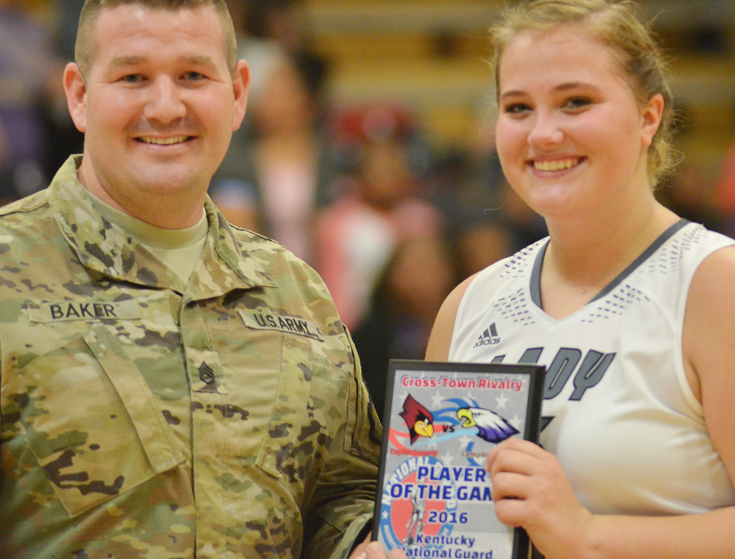 CHS senior Brenna Wethington receives the Player of the Game award from Army National Guard Sgt. Phillip Baker.