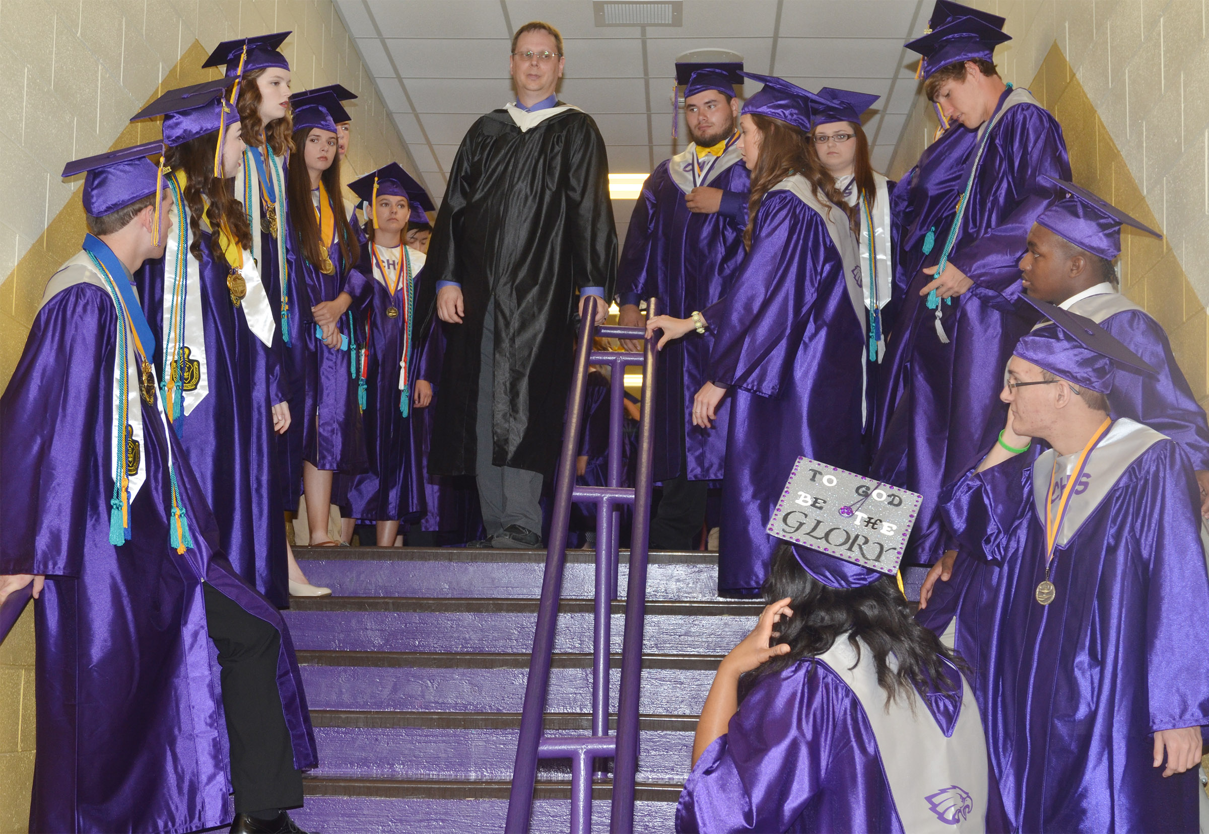 CHS Guidance Counselor Richard Dooley waits with the Class of 2017 for their graduation ceremony to begin.
