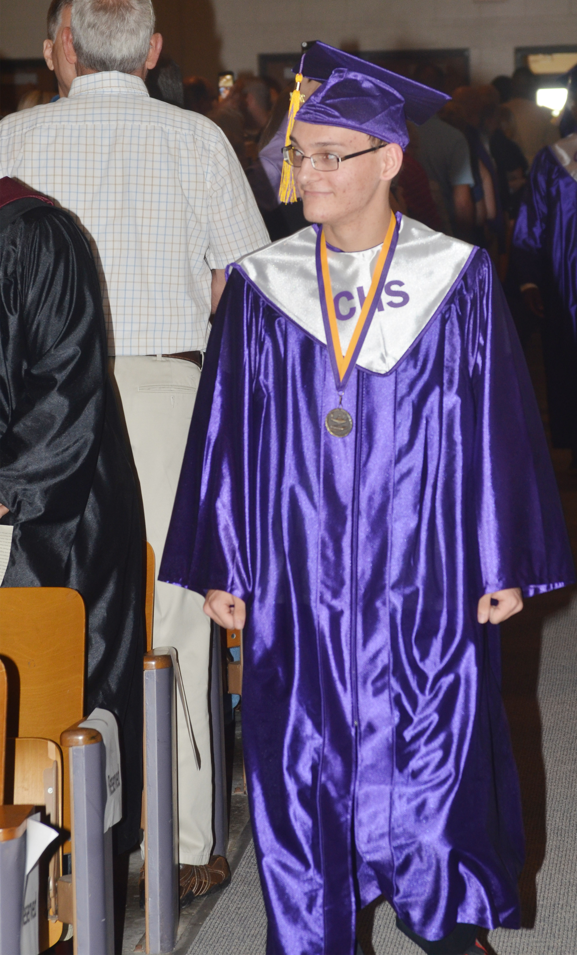 CHS senior Chase Atwood walks to his seat.