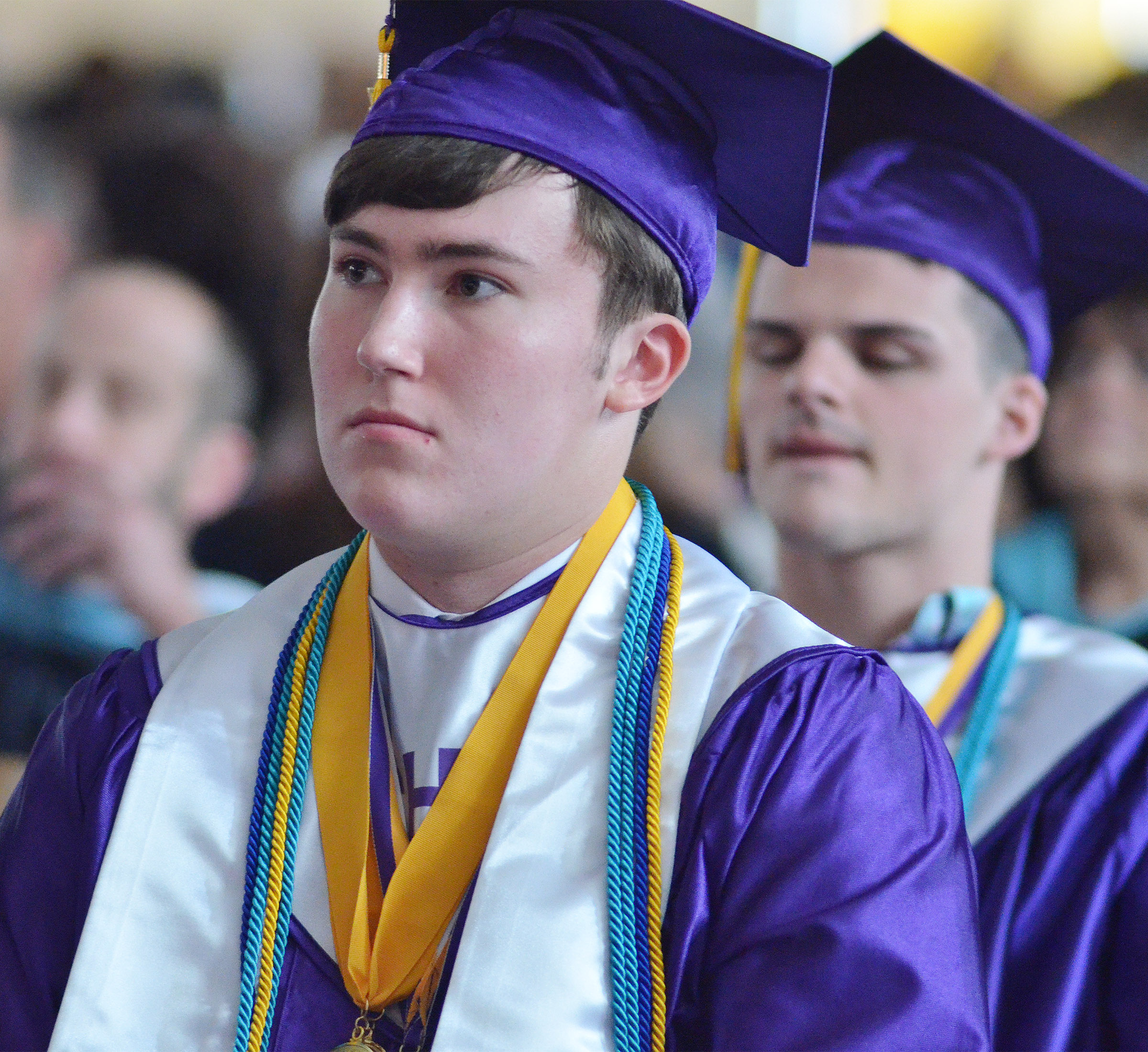 CHS senior Zack Settle listens as Principal Kirby Smith speaks to his class.