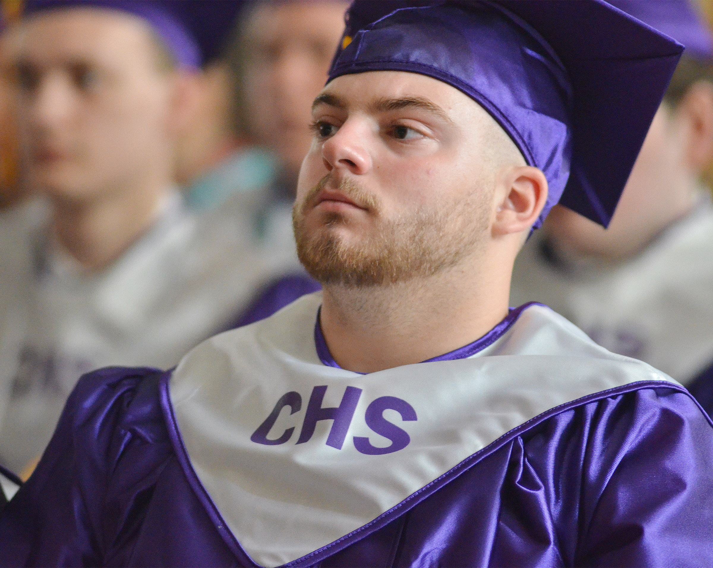 CHS senior Jon Tanner Coppage listens as Principal Kirby Smith addresses his class.
