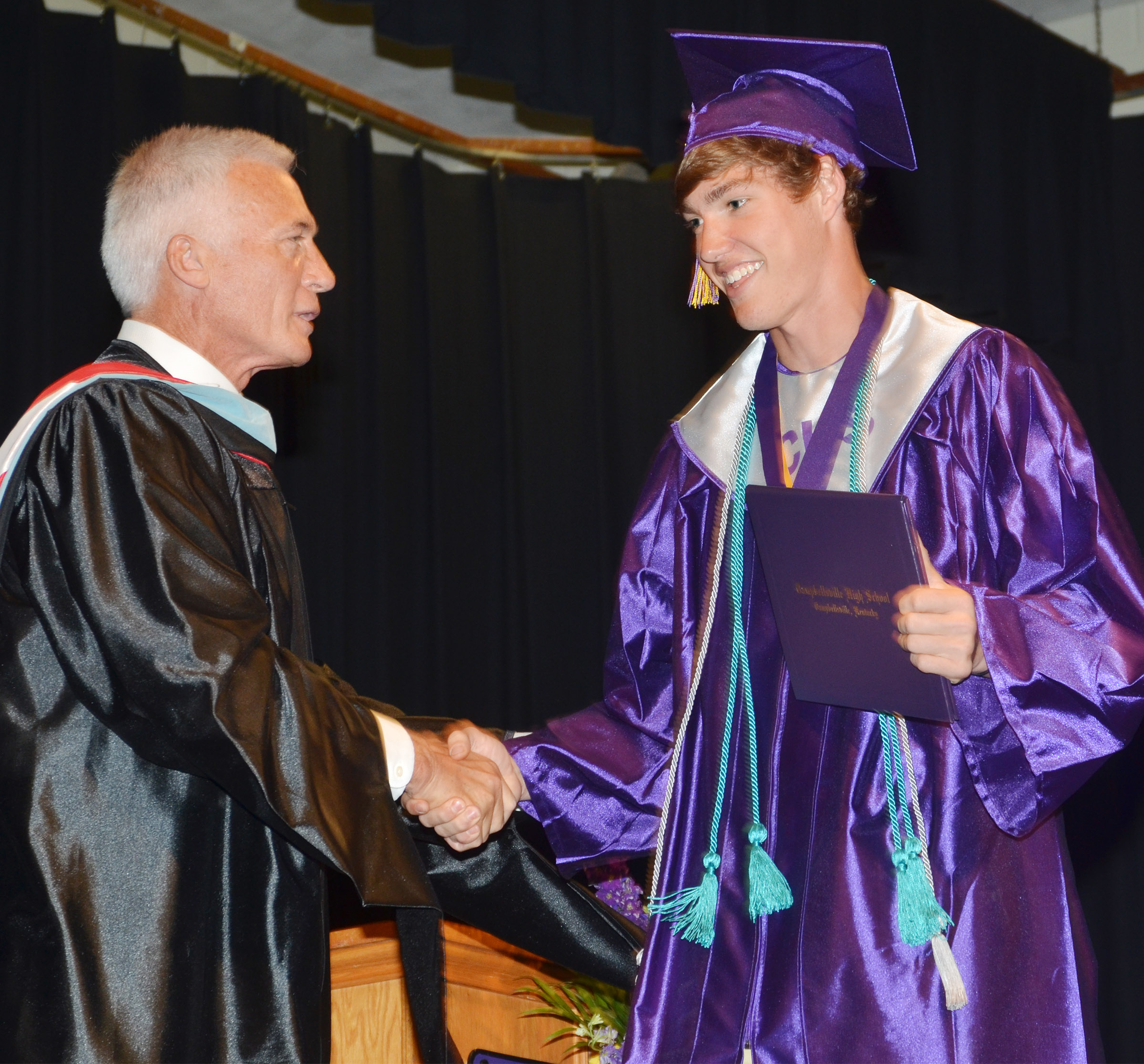 Campbellsville Independent Schools Superintendent Mike Deaton congratulates Zack Bottoms.