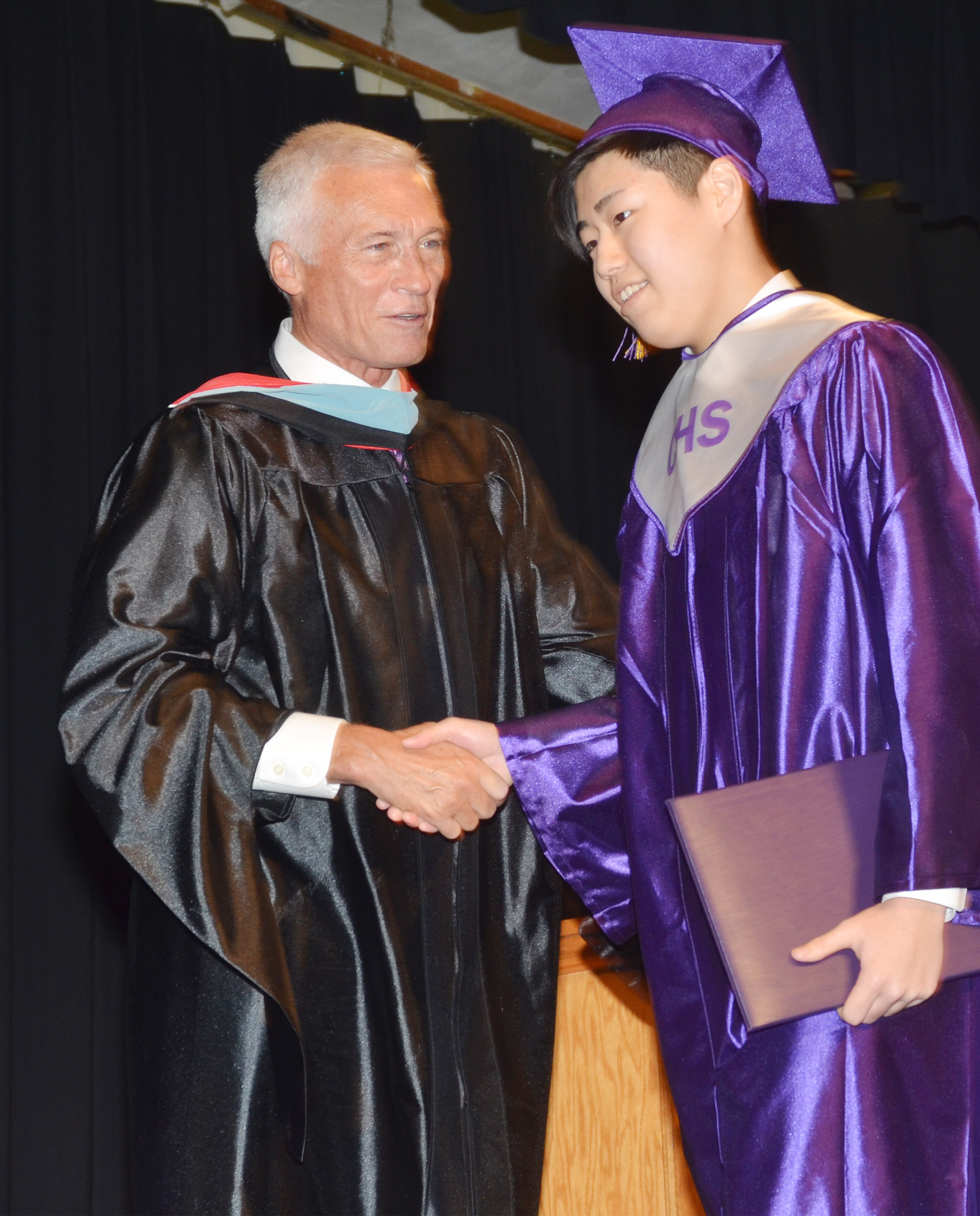 Campbellsville Independent Schools Superintendent Mike Deaton congratulates Iori Hashimoto.