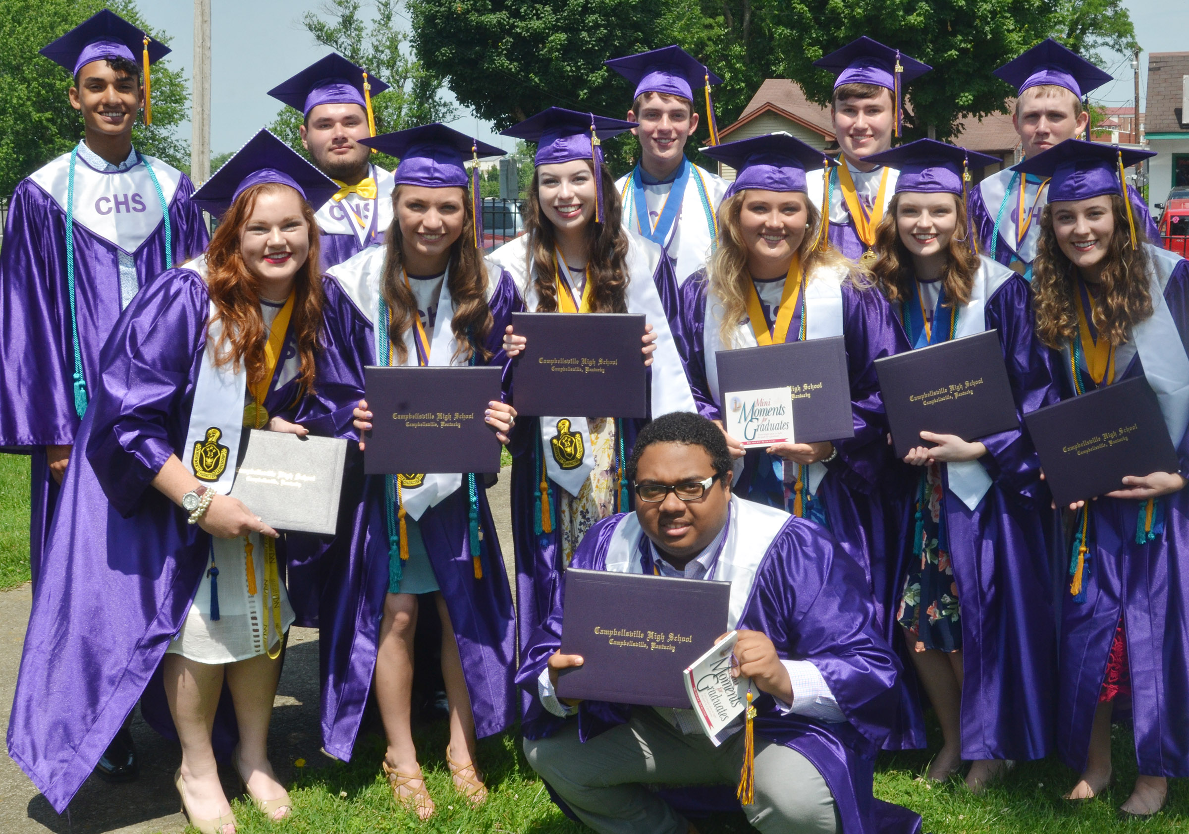 CHS graduates pose for a photo after graduation. In front is Ricky Smith-Cecil. Second row, from left, Mallory Haley, Caylie Blair, Laura Lamb, Brenna Wethington, Blair Lamb and Caroline McMahan. Back, Daniel Silva, Logan Brown, Murphy Lamb, Zack Settle and Jared Brewster.