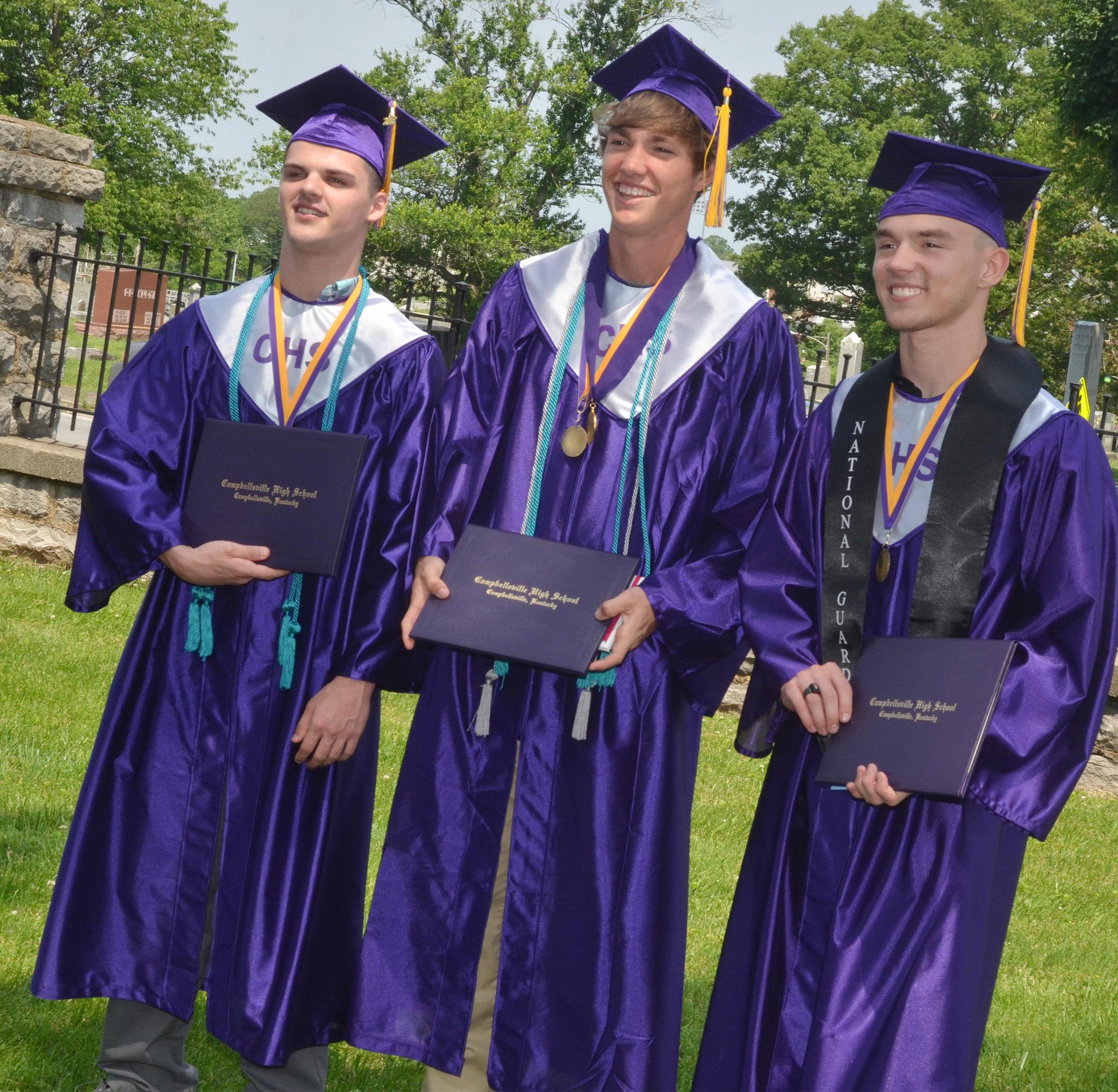 From left, CHS graduates Stone Williams, Zack Bottoms and Jordan Pratt pose for a photo together.