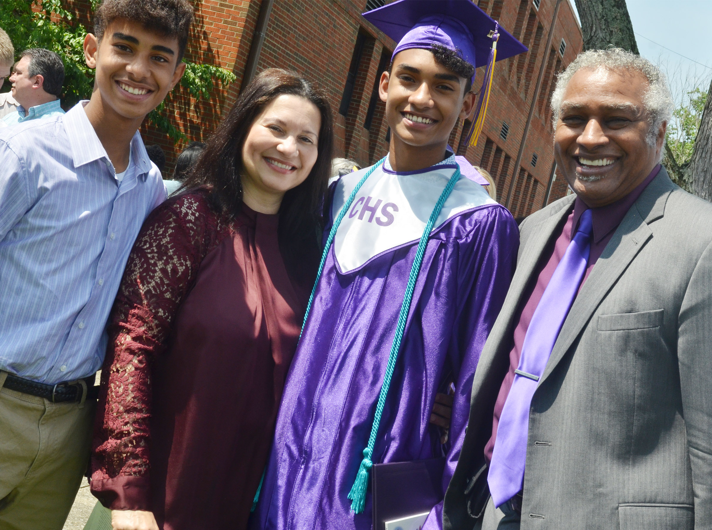 CHS graduate Daniel Silva poses for a photo with his parents, Dewayne and Dr. Carla Golightly, and his brother, David, a freshman at CHS.