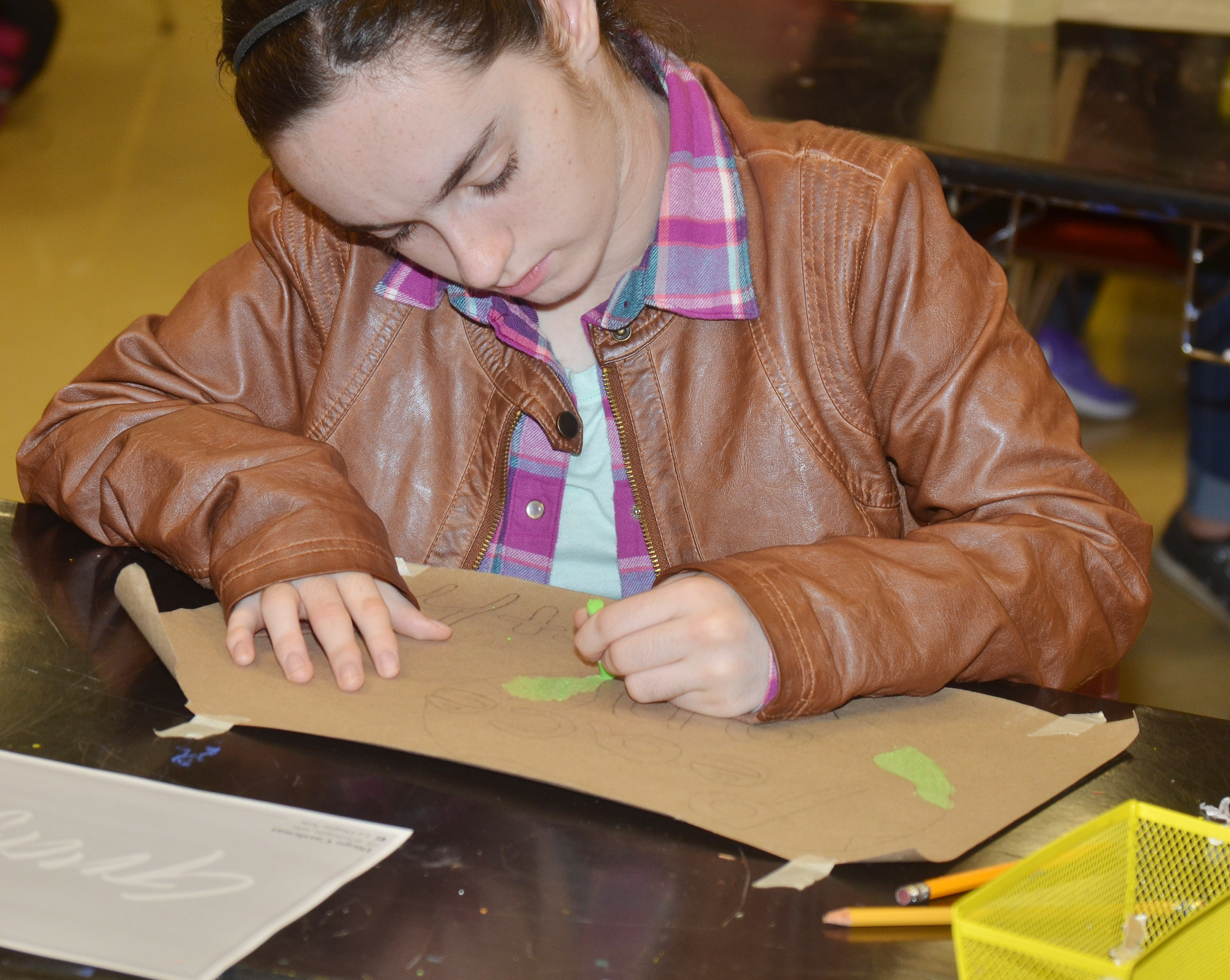 CHS sophomore Jewell Cox uses oil pastels to add color to her graffiti-style art.