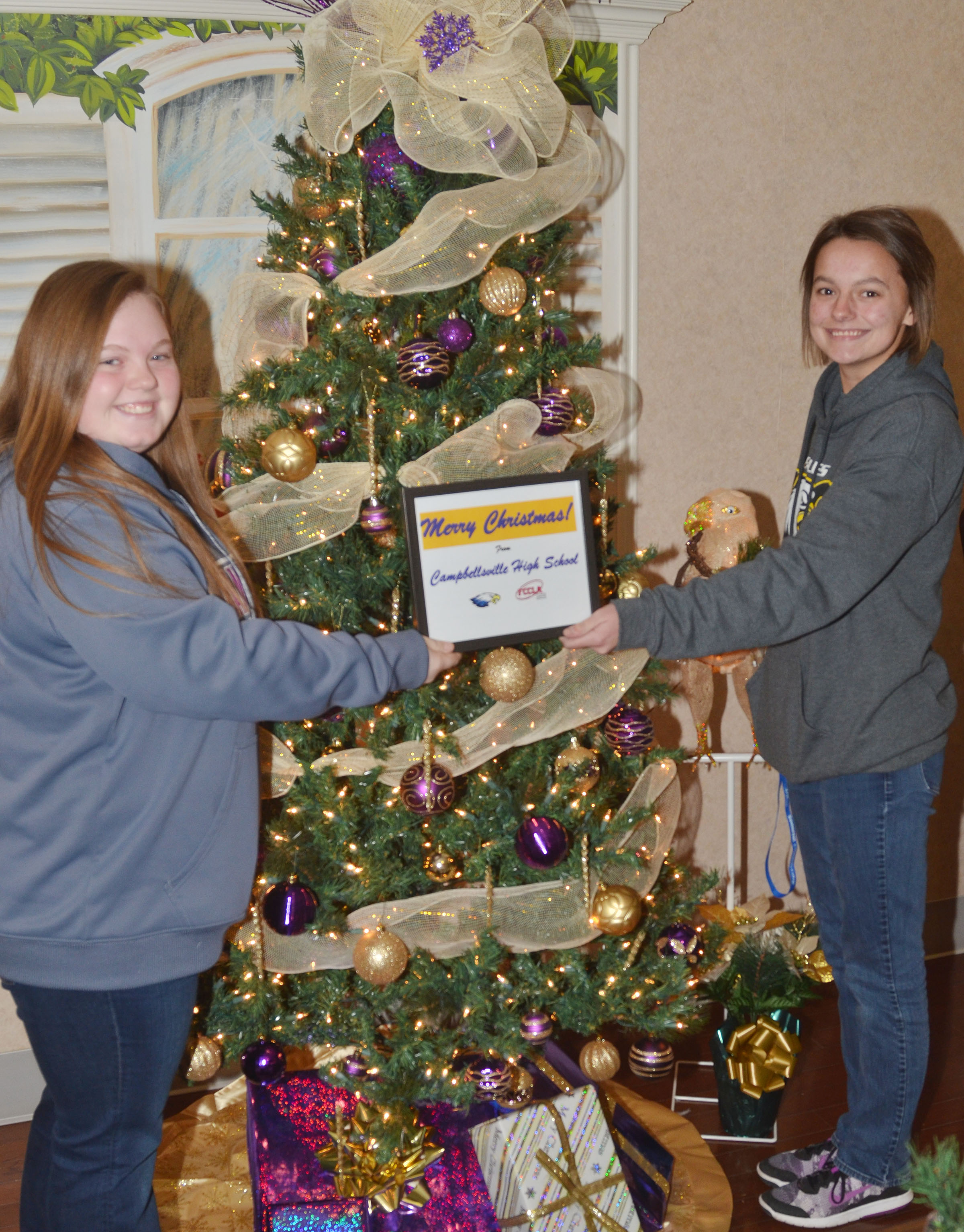 CHS seniors Madison Lewis, at left, and Kyrsten Hill decorated the FCCLA club's Christmas tree, which is on display at the Grandview.