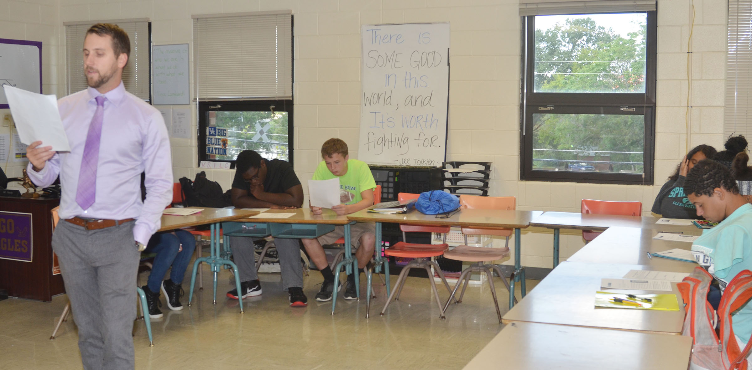 "CHS English teacher Tyler Hardy reads ""Sleep and the Teenage Brain"" to his students. After reading the article, students debated as to whether school should start at 8 a.m. or later."