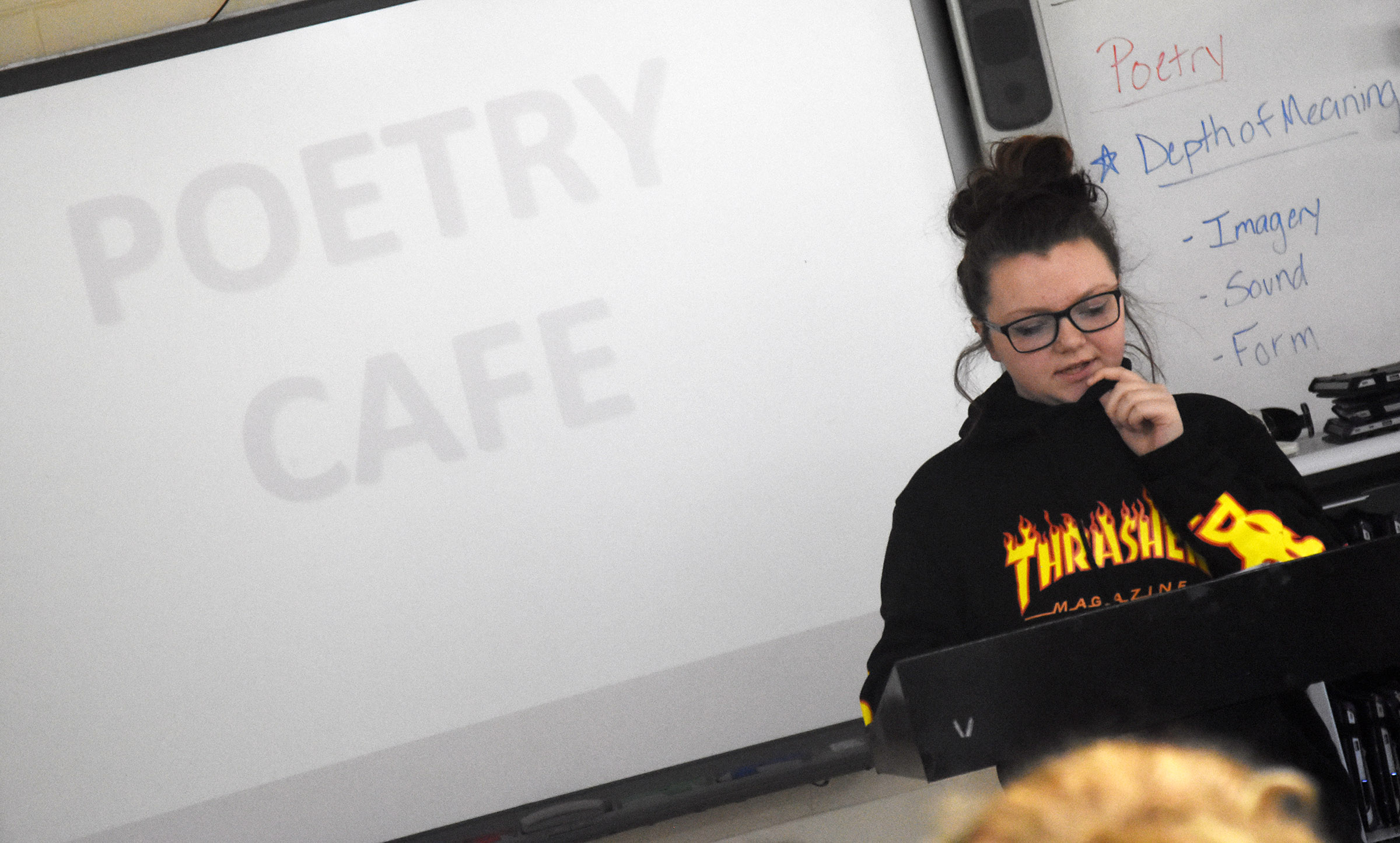 Campbellsville High School freshman Abigail Decker reads her poetry.