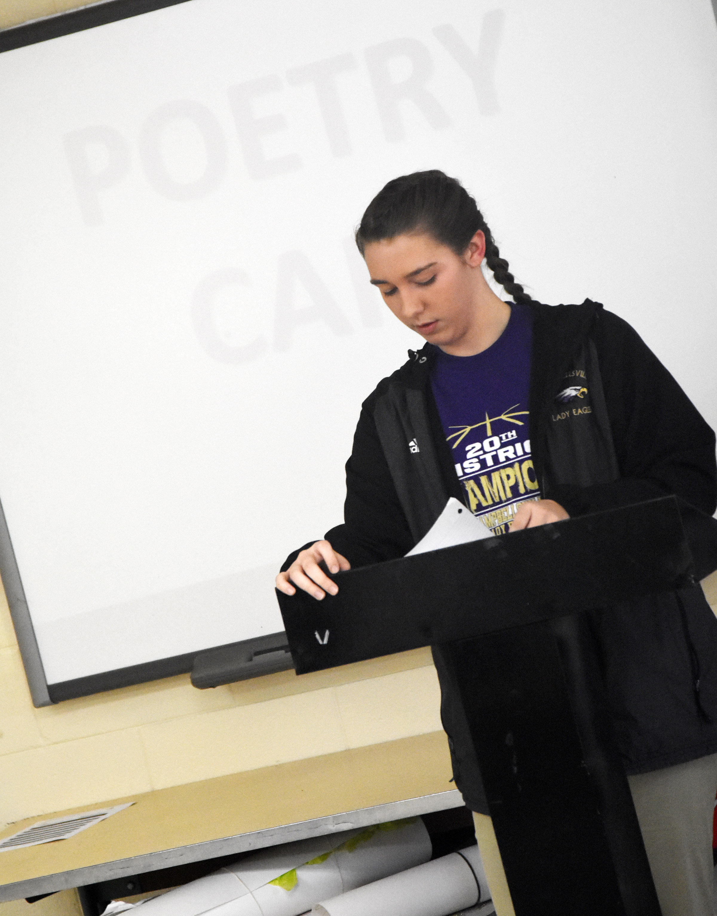 Campbellsville High School freshman Abi Wiedewitsch reads her poetry.
