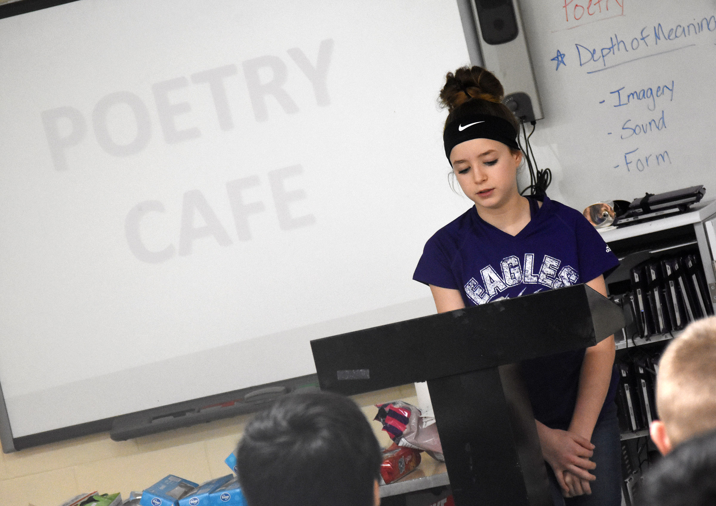 Campbellsville Middle School eighth-grader Rylee Petett reads her poetry.
