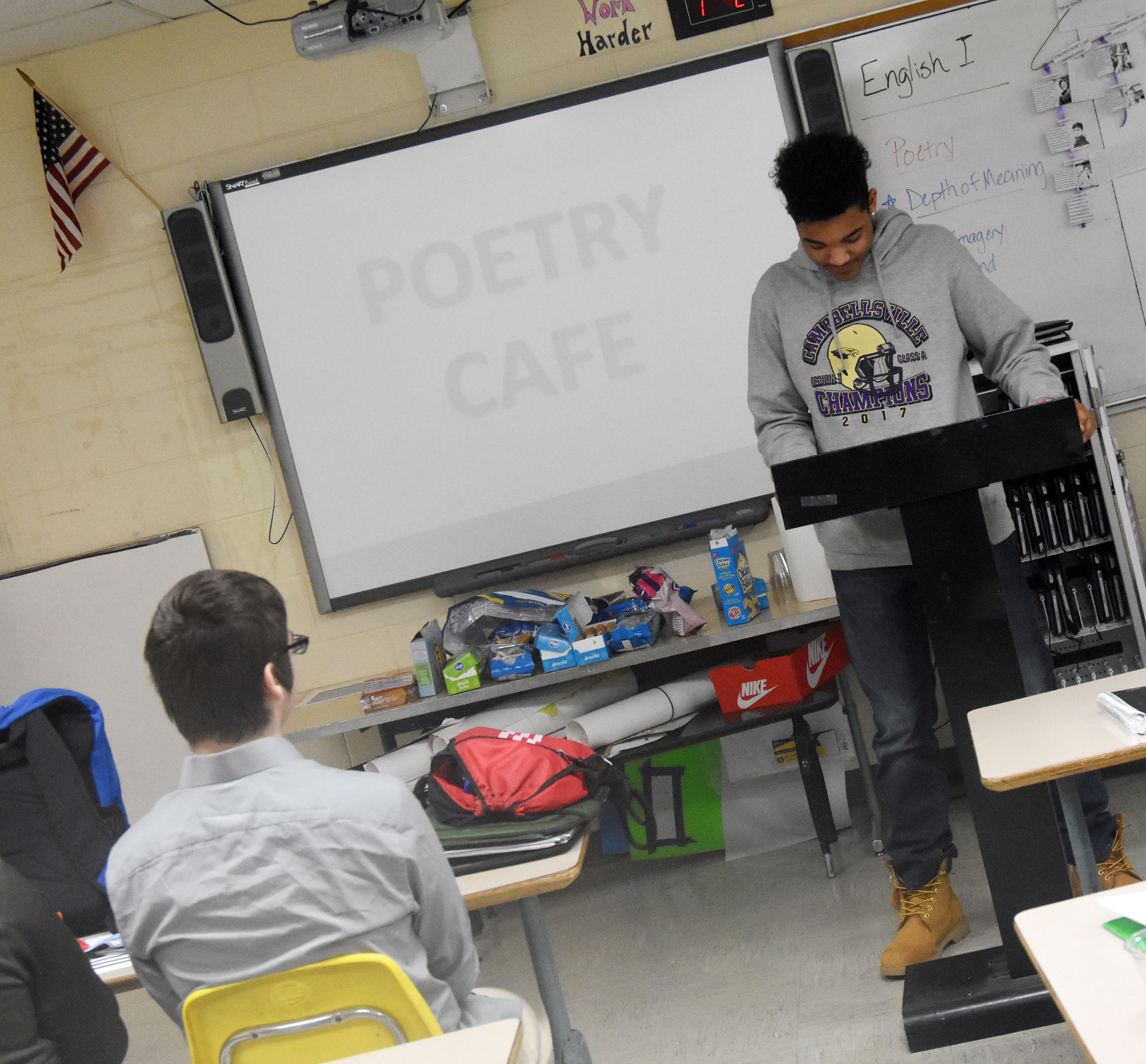 Campbellsville High School freshman Reggie Thomas reads his poetry.
