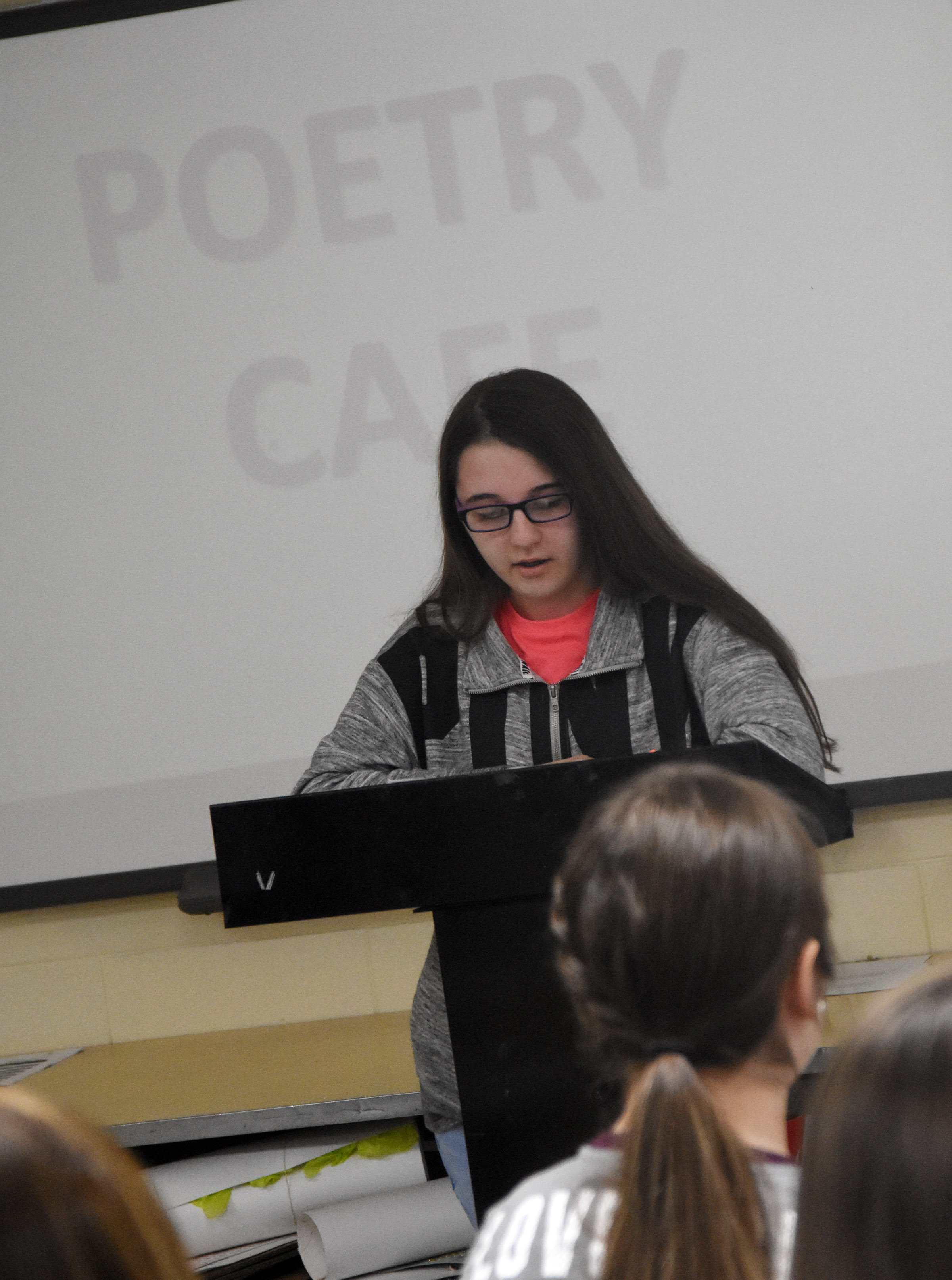 Campbellsville High School freshman Chloe Cox reads her poetry.