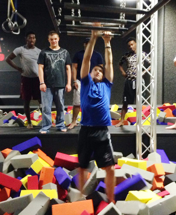 CHS Senior Clayton Russell Makes His Way Through An Obstacle Course.