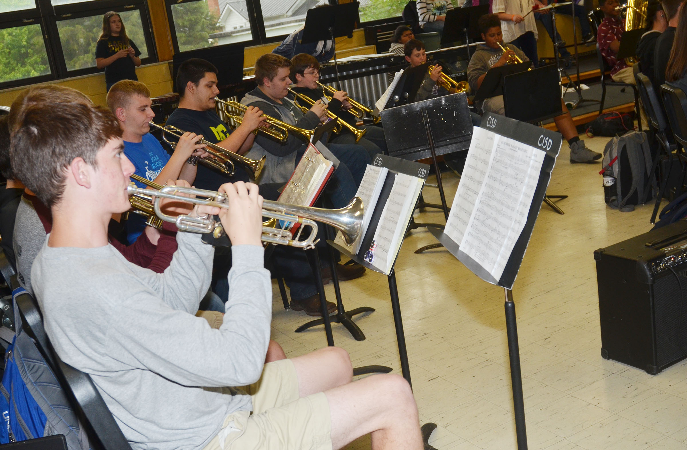 CHS senior Murphy Lamb and his fellow trumpet players play.