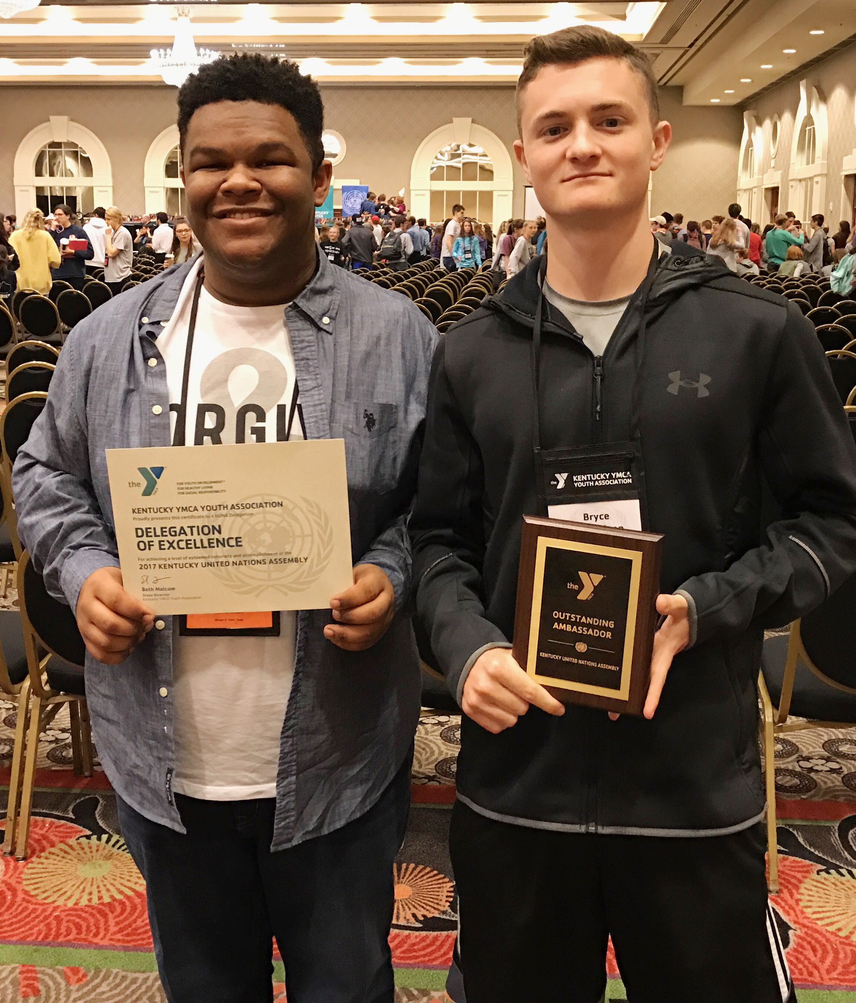CHS sophomore Jeremiah Jackson, at left, accepts his school's Delegation of Excellence award and junior Bryce Richardson receives an Outstanding Delegate award.