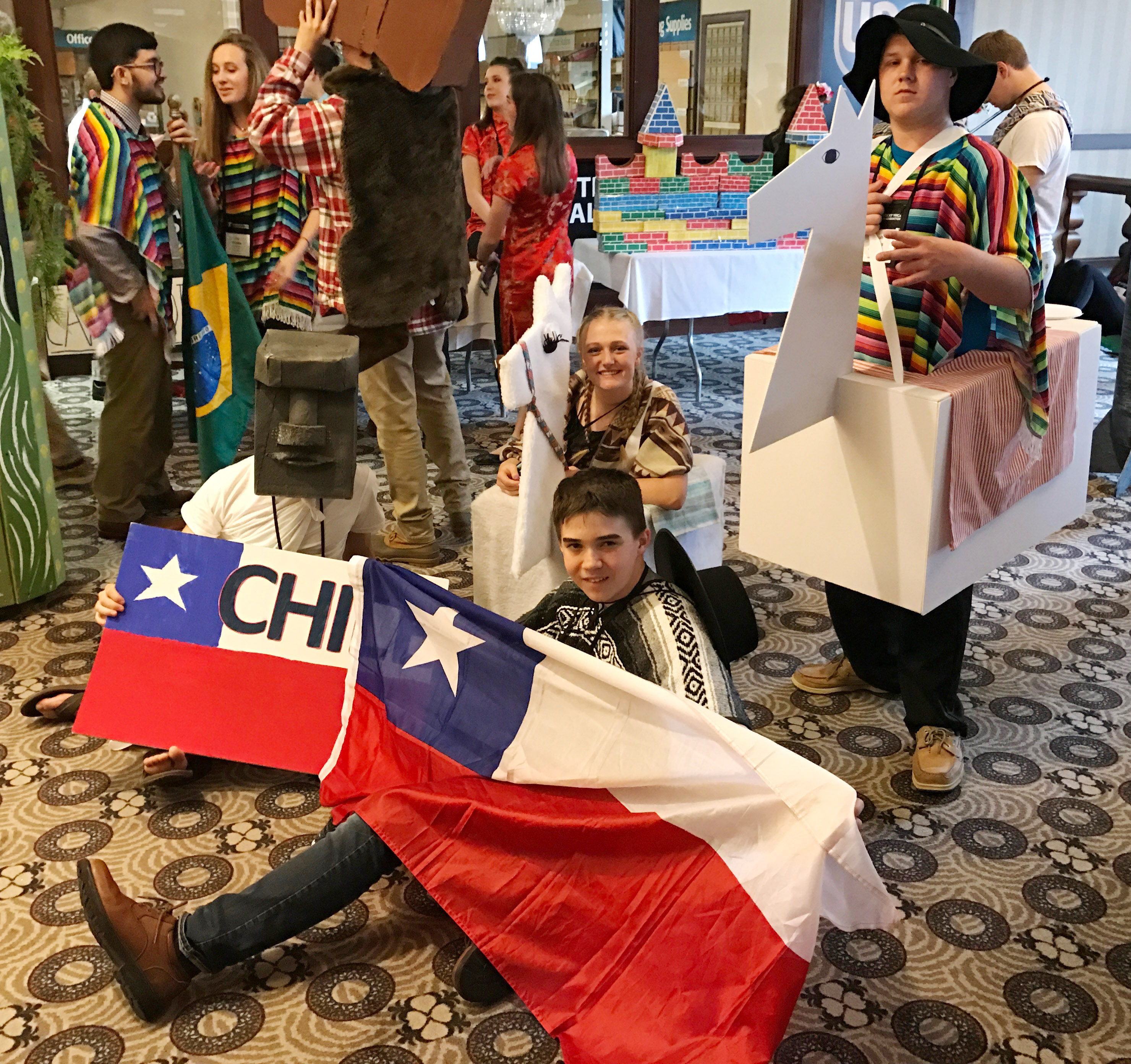 From left, CHS junior Bryce Richardson, sophomore Abbie Dicken, freshman Cole Kidwell and senior Noah Wagers dress for their presentation about Chile.