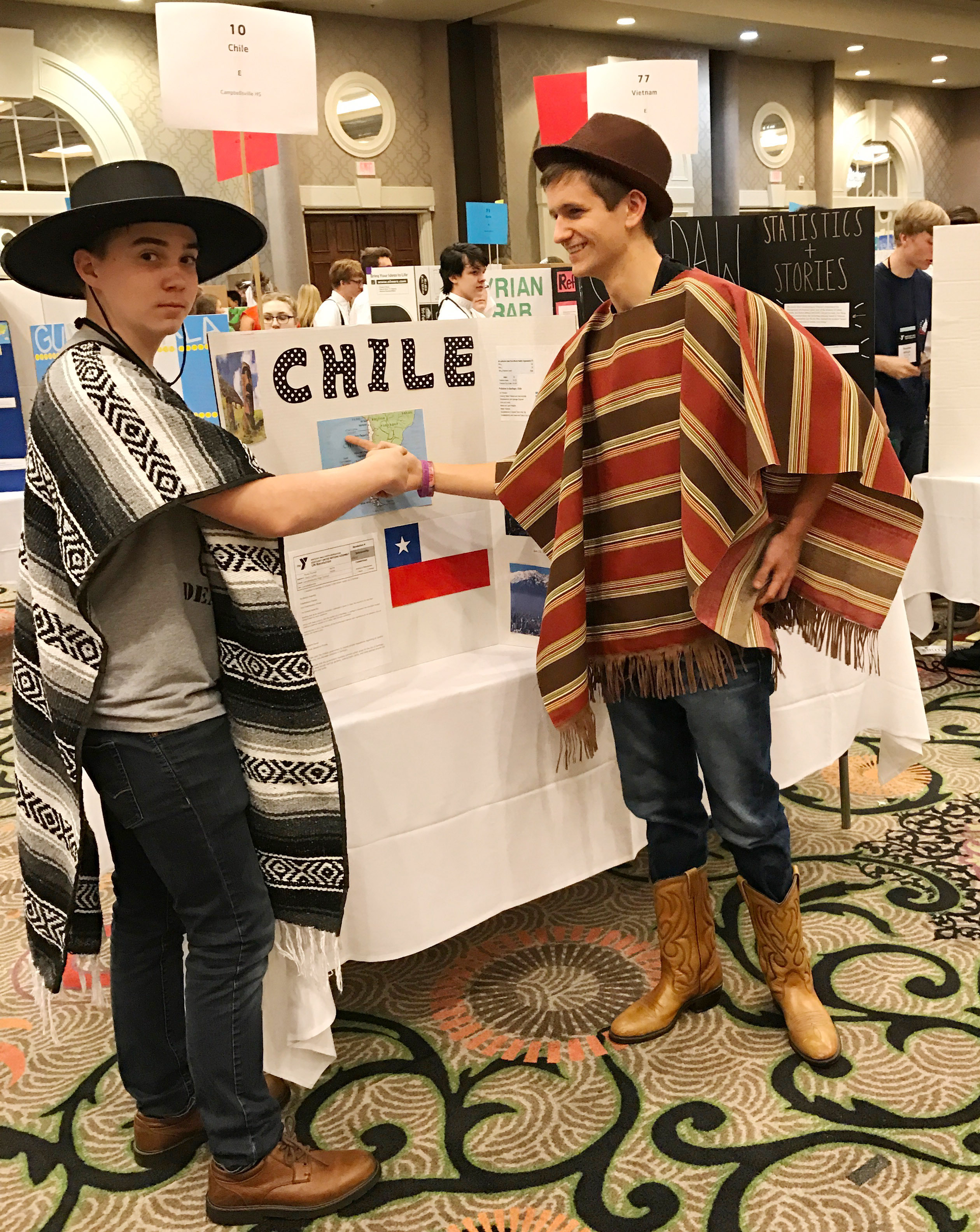 CHS freshman Cole Kidwell, at left, and junior Myles Murrell dress for the group's presentation about Chile.