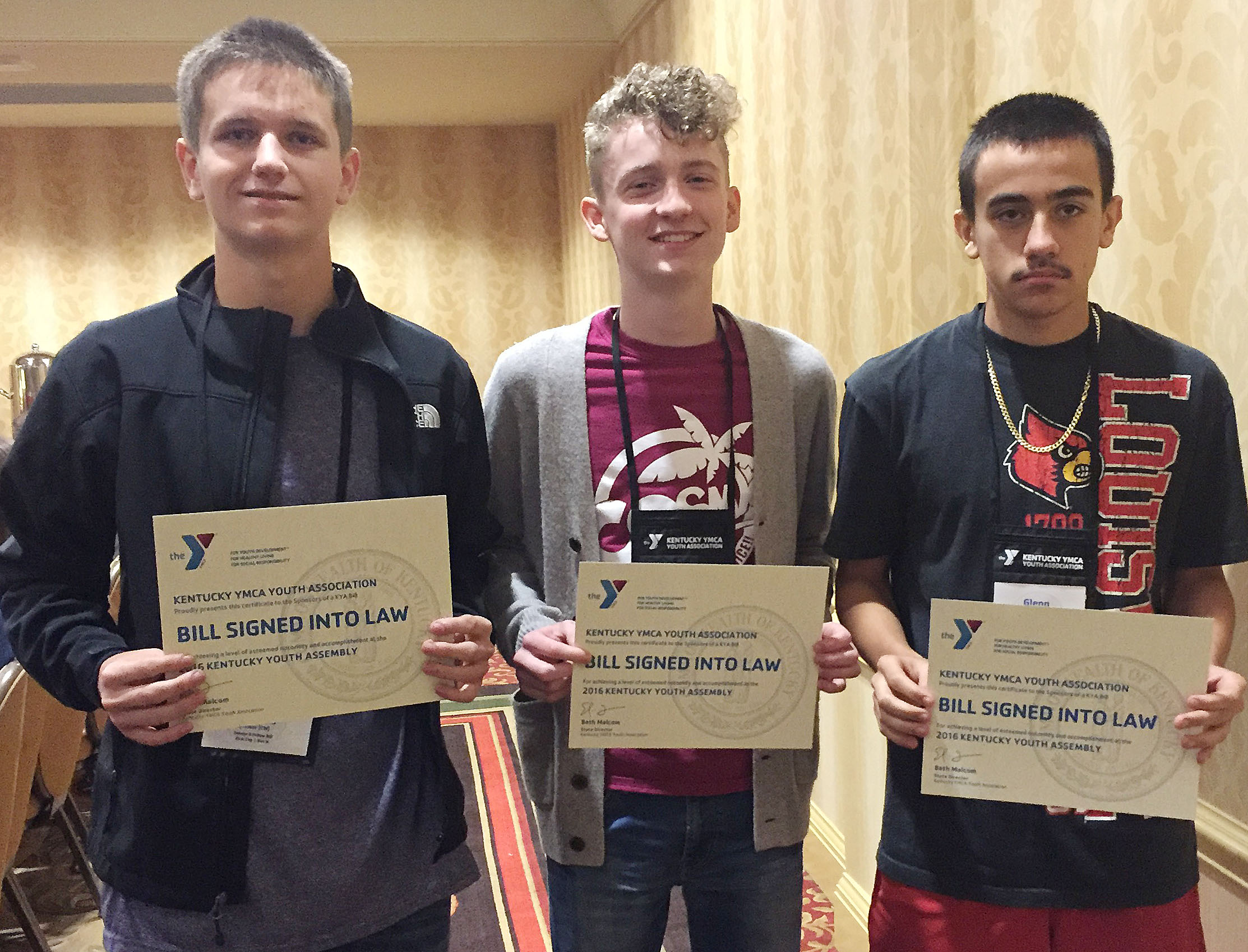 CHS sophomores, from left, Myles Murrell, Jackson Hinton and Glenn Lamer authored a bill that was signed into law at this year's KYA session.