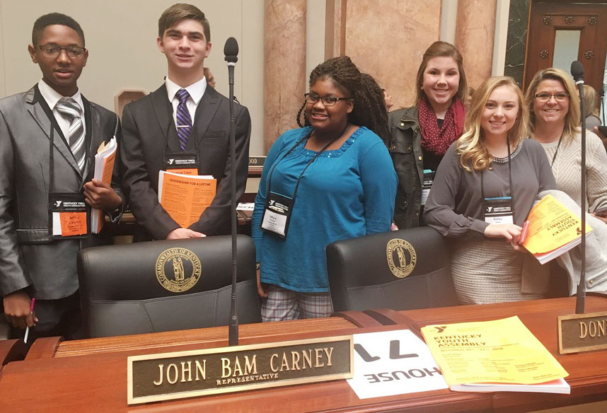 CHS Kentucky YMCA Youth Association members pose for a photo in the House of Representatives at the state capitol in Frankfort. From left are senior Jaleel Cowan, junior Cass Kidwell, freshmen Jakyia Mitchell, Lauryn Agathen and Bailey Smith and chaperone Missy Hughes.