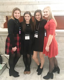 From left, sophomores Lauryn Agathen, Alli Wilson, Bailey Thompson and Isabella Osborne pose for a photo at KYA.
