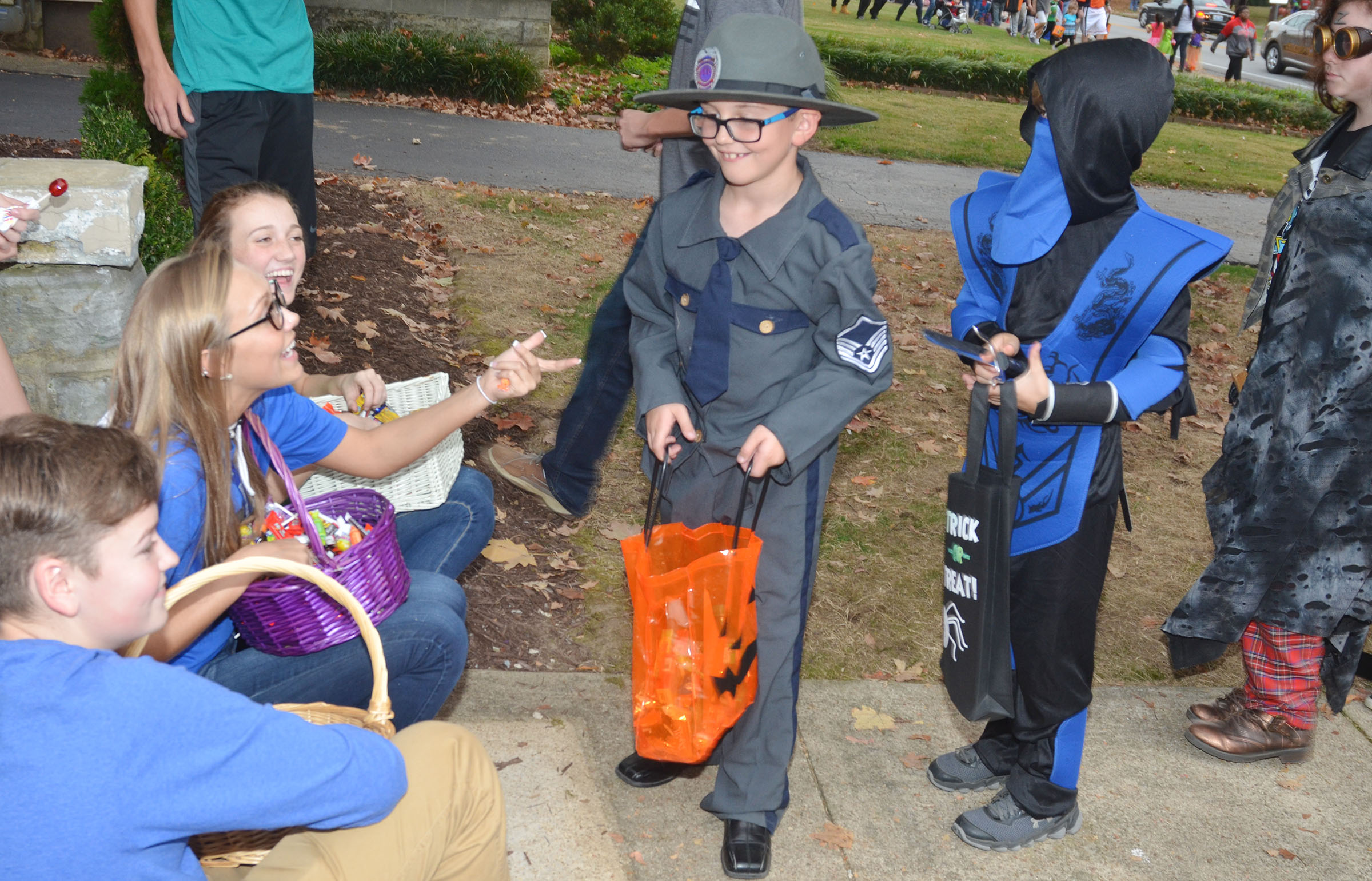 CHS KYA members, from left, freshman Gavin Johnson and sophomores Tatem Wiseman and Salena Ritchie pass out Halloween candy to Campbellsville Elementary School second-grader Tye Rhodes.