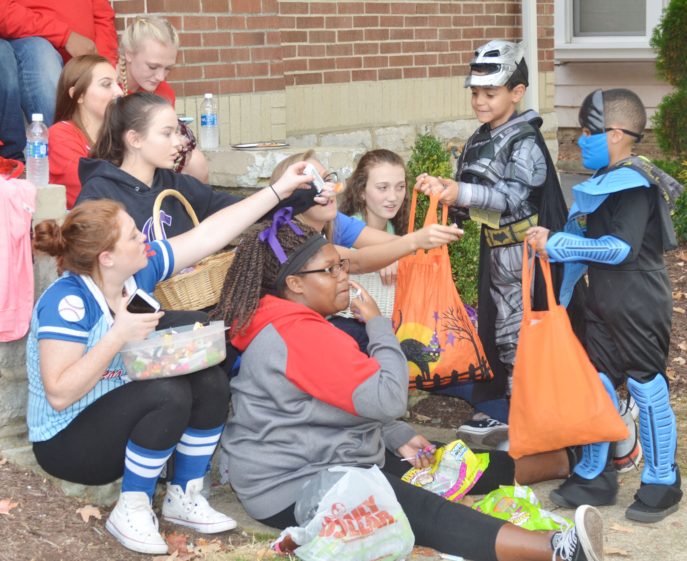 CHS KYA members pass out candy to trick or treaters.