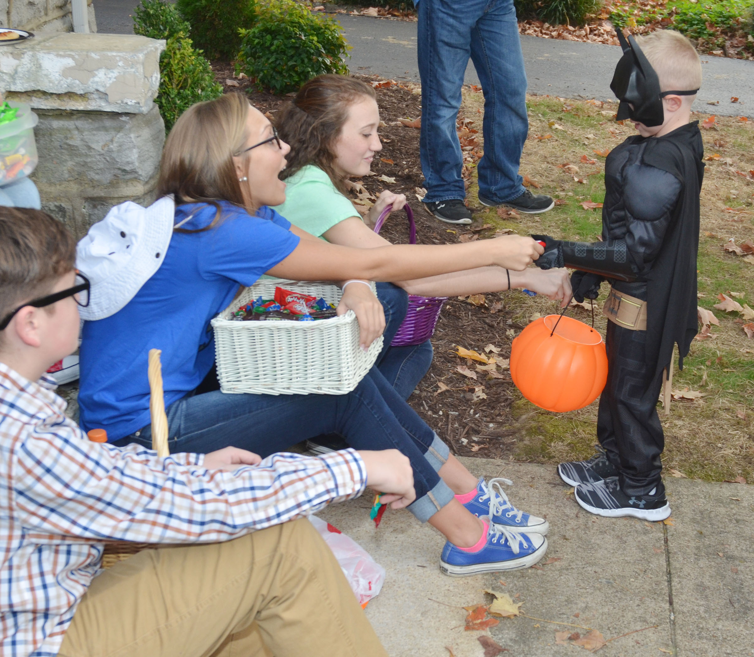 CHS KYA members, from left, freshman Gavin Johnson and sophomores Tatem Wiseman and Salena Ritchie pass out Halloween candy to Campbellsville Elementary School kindergartener Jackson Wright.