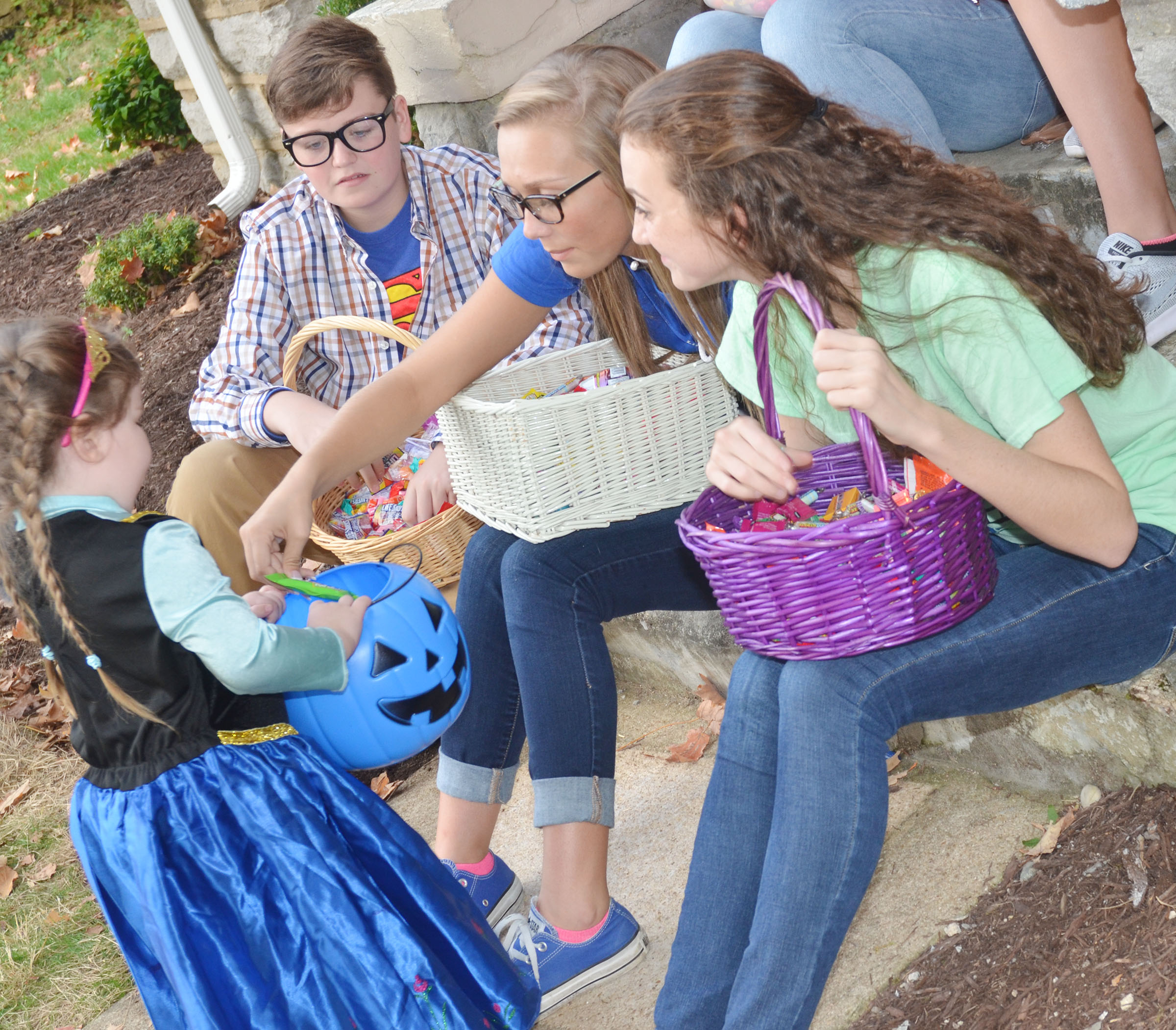 CHS KYA members, from left, freshman Gavin Johnson and sophomores Tatem Wiseman and Salena Ritchie pass out Halloween candy.