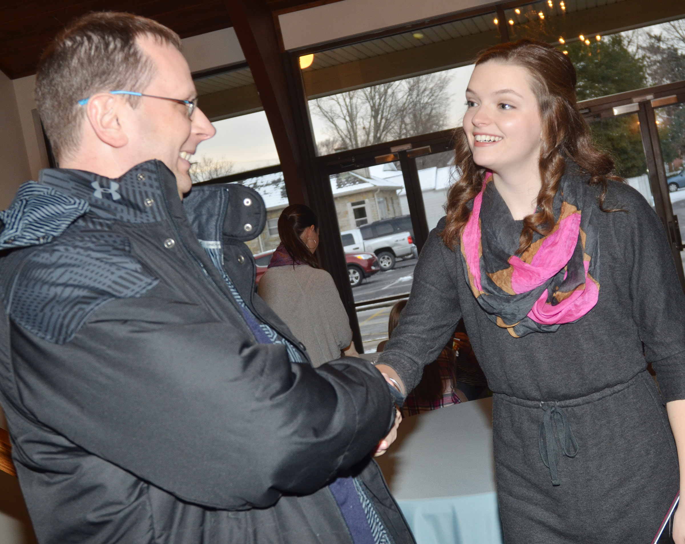 CHS senior Blair Lamb was honored at a reception on Friday, Jan. 6, before she left to compete in the Kentucky Distinguished Young Women competition. Above, she is congratulated by CHS Guidance Counselor Richard Dooley.