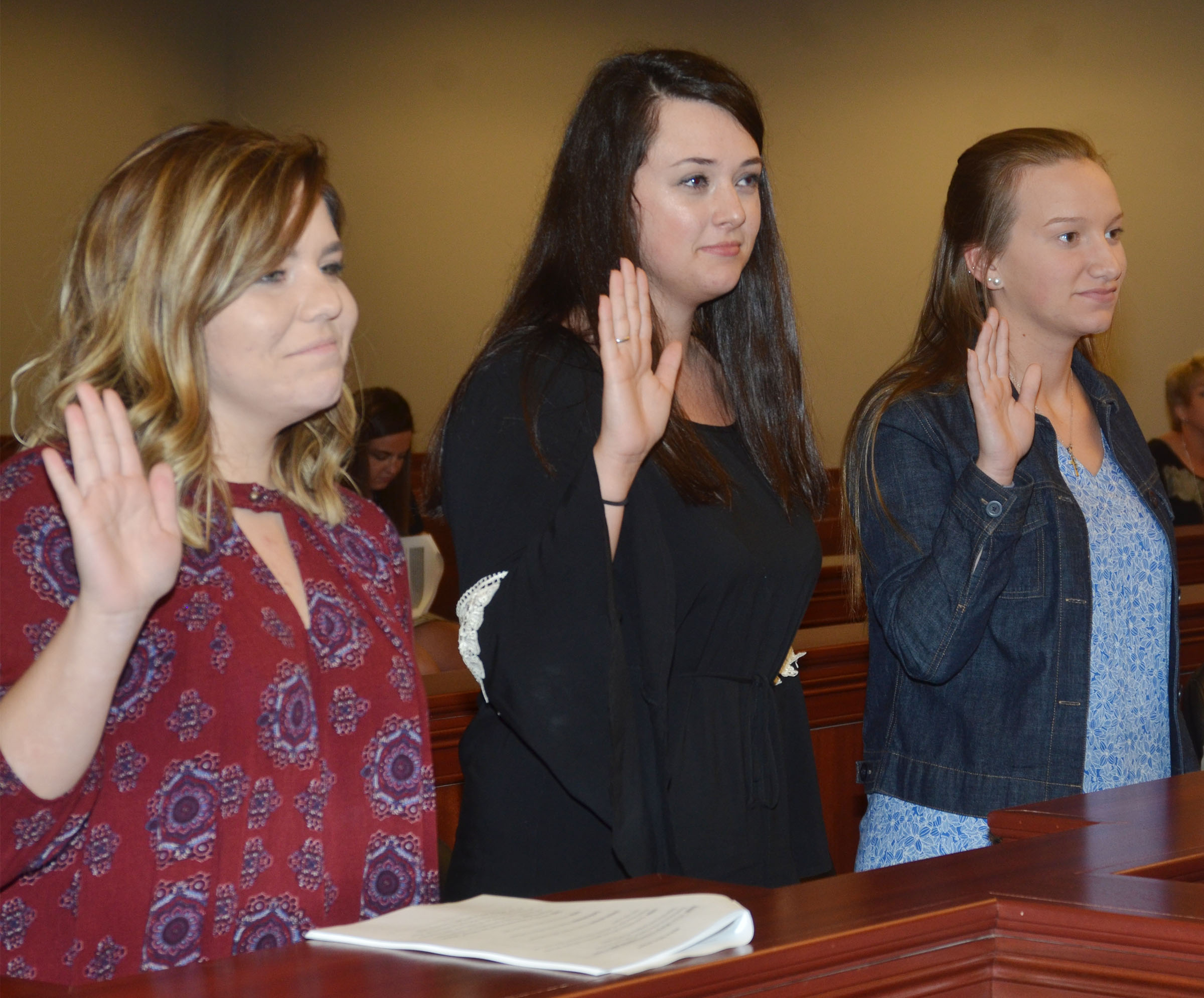 From left, CHS juniors Sara Farmer, Missy Vanorder and Madison Dial are sworn in as jurors during the mock trial.