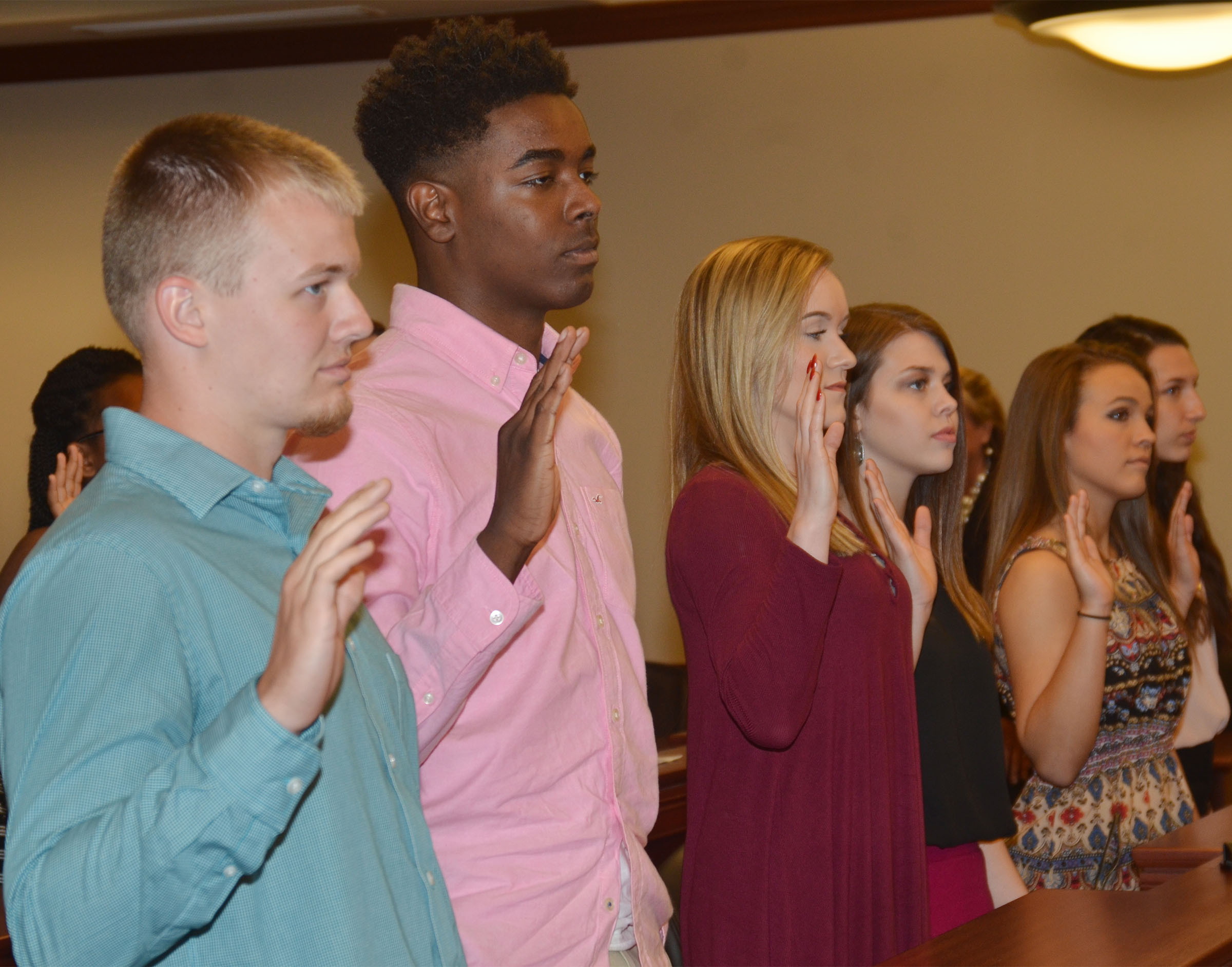 CHS juniors Wyatt Houk and Chanson Atkinson, at left, are sworn in as jurors during the mock trial.