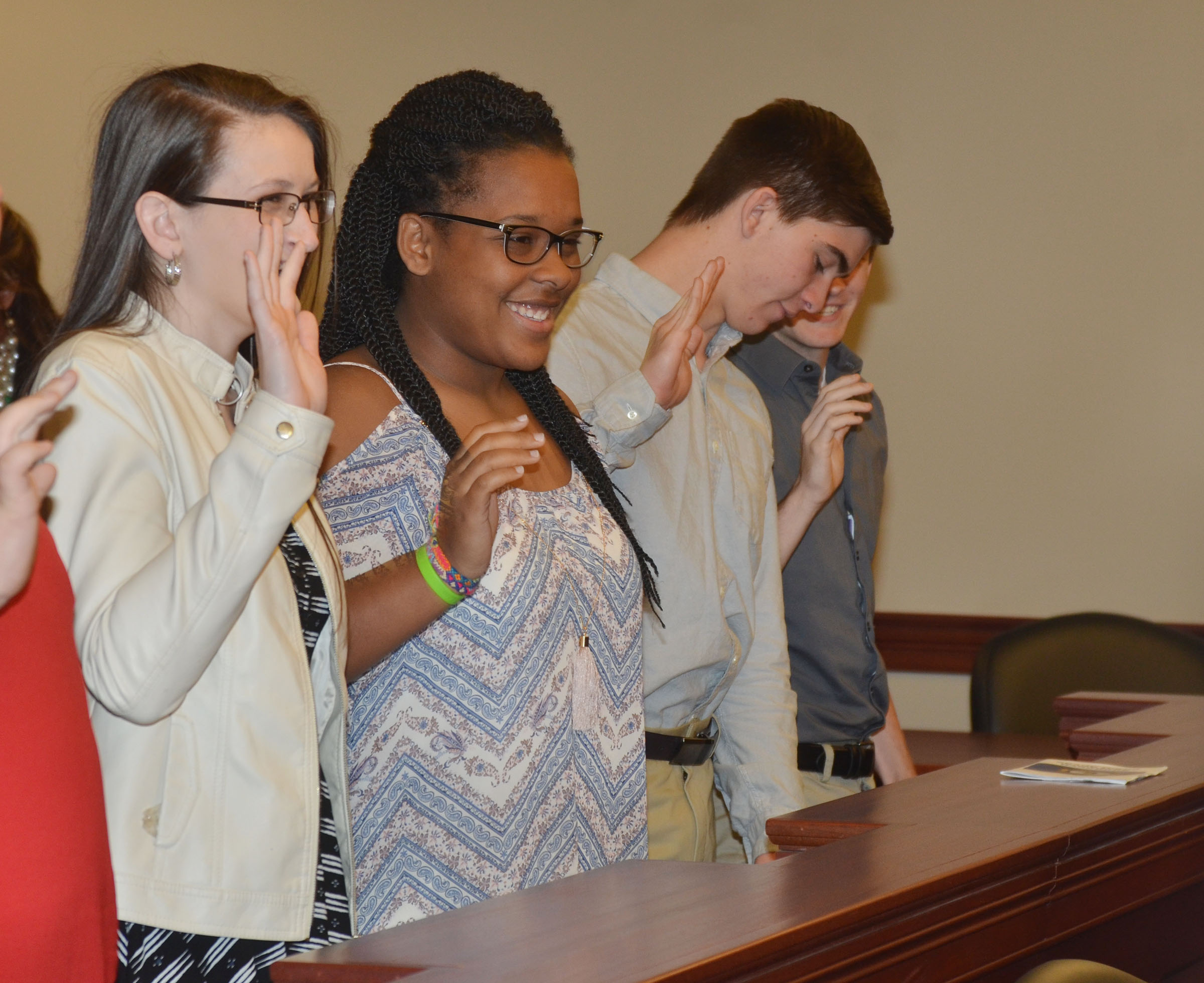 From left, CHS juniors Kimberly Harden, Kayla Young and Cass Kidwell are sworn in as jurors during the mock trial.