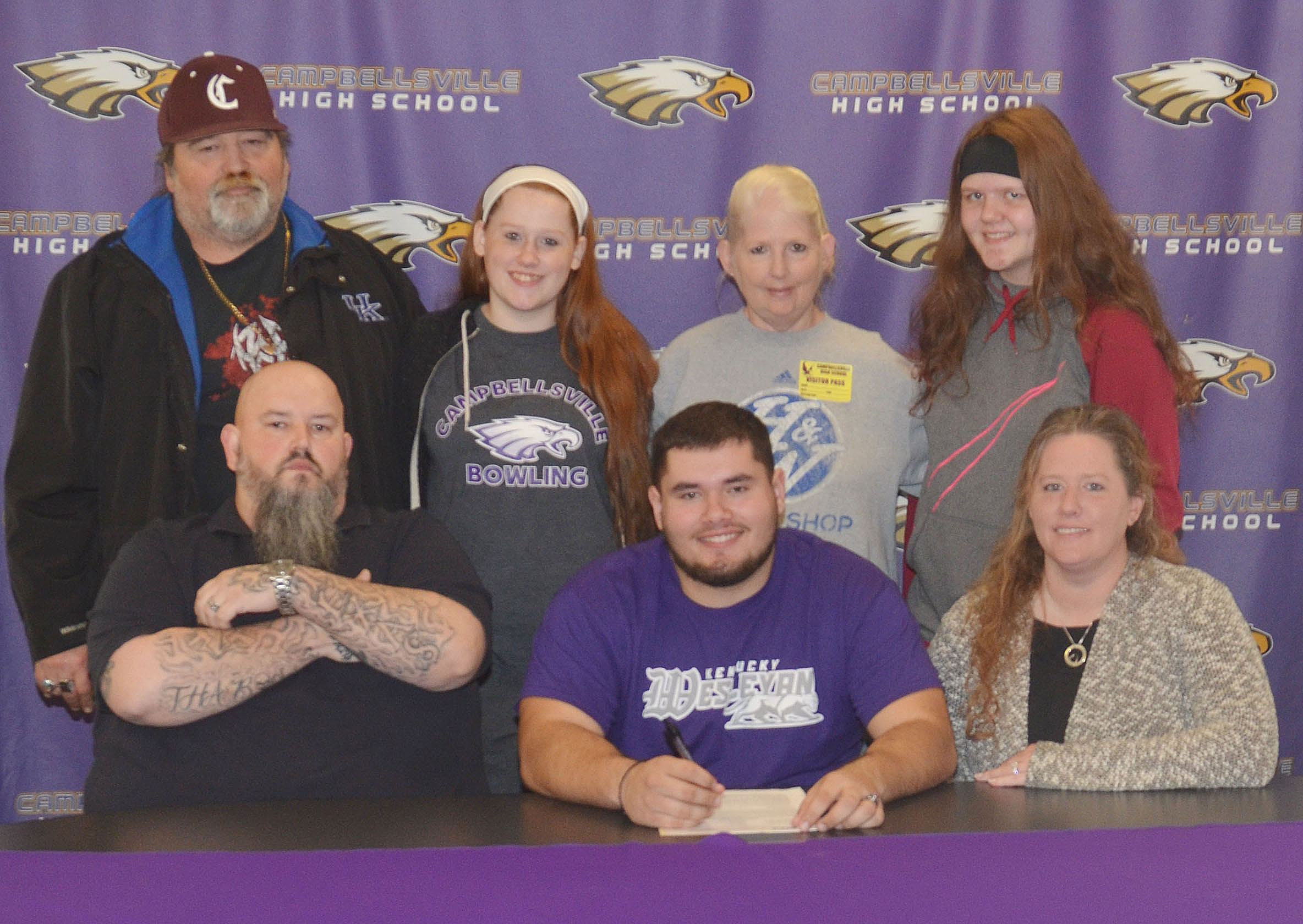 Campbellsville High School football player Logan Brown will continue his academic and football career at Kentucky Wesleyan College this fall. He officially signed his letter of intent on Wednesday, Feb. 1, which was National Signing Day. From left, front, are stepfather Johnny Welch, Logan, and his mother, Krissy Welch. Back, grandfather Joe Pendleton, sister and CHS sophomore Gracie Miller, grandmother Kim Pendleton, and sister and Campbellsville Middle School seventh-grader Autumn Brown.