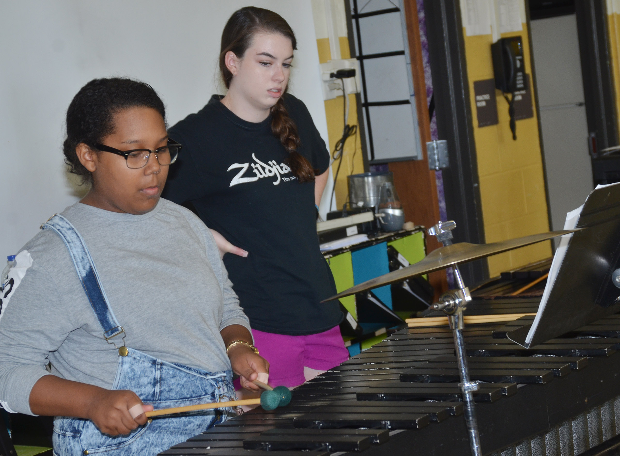 CHS sophomore Zaria Cowan practices, with some help from Laura Lamb, a marching band member who graduated from CHS last May.