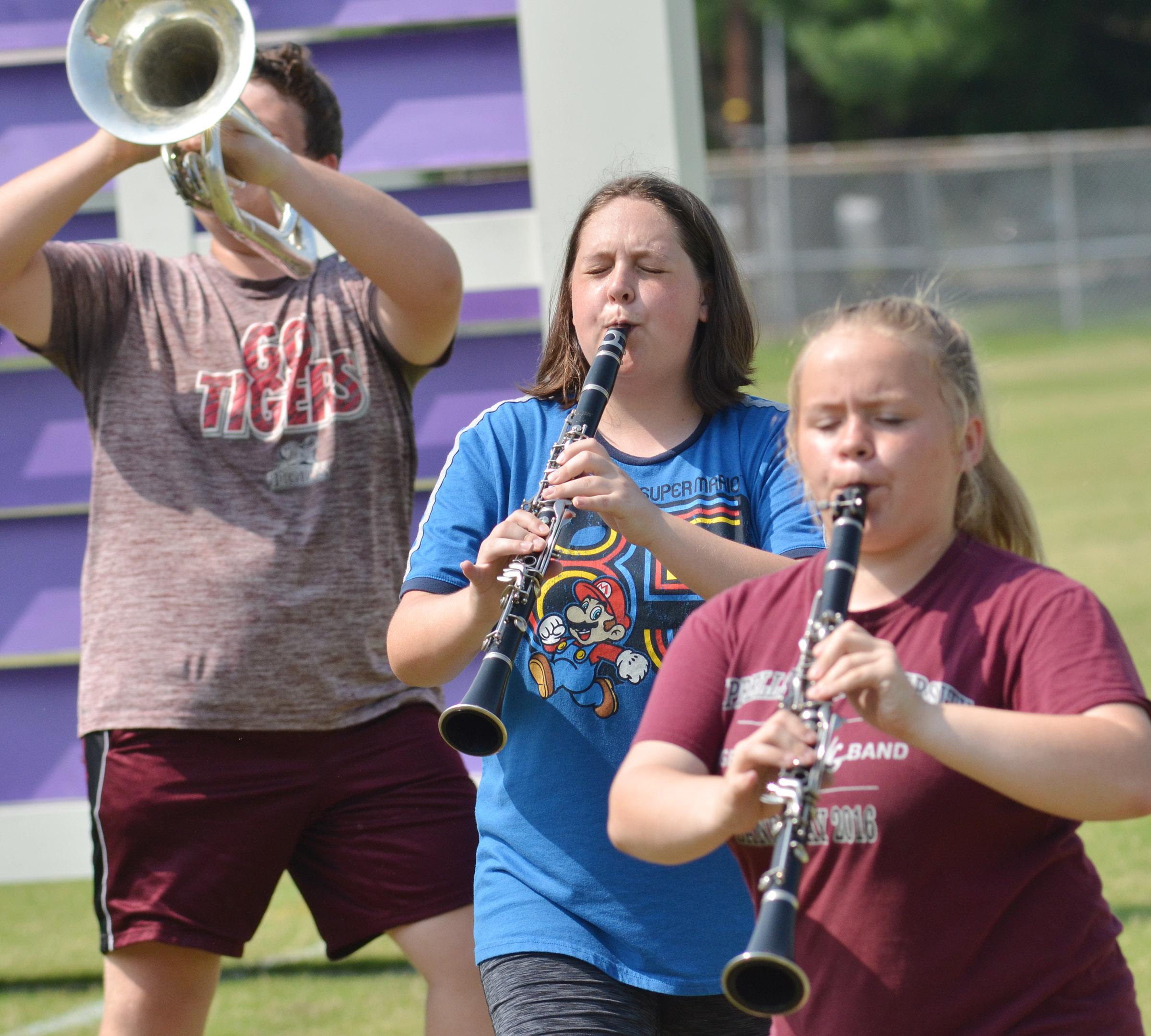 CHS junior Ruby Hatfield closes her eyes as she and Campbellsville Middle School eighth-grader Riley Rainwater play clarinet.