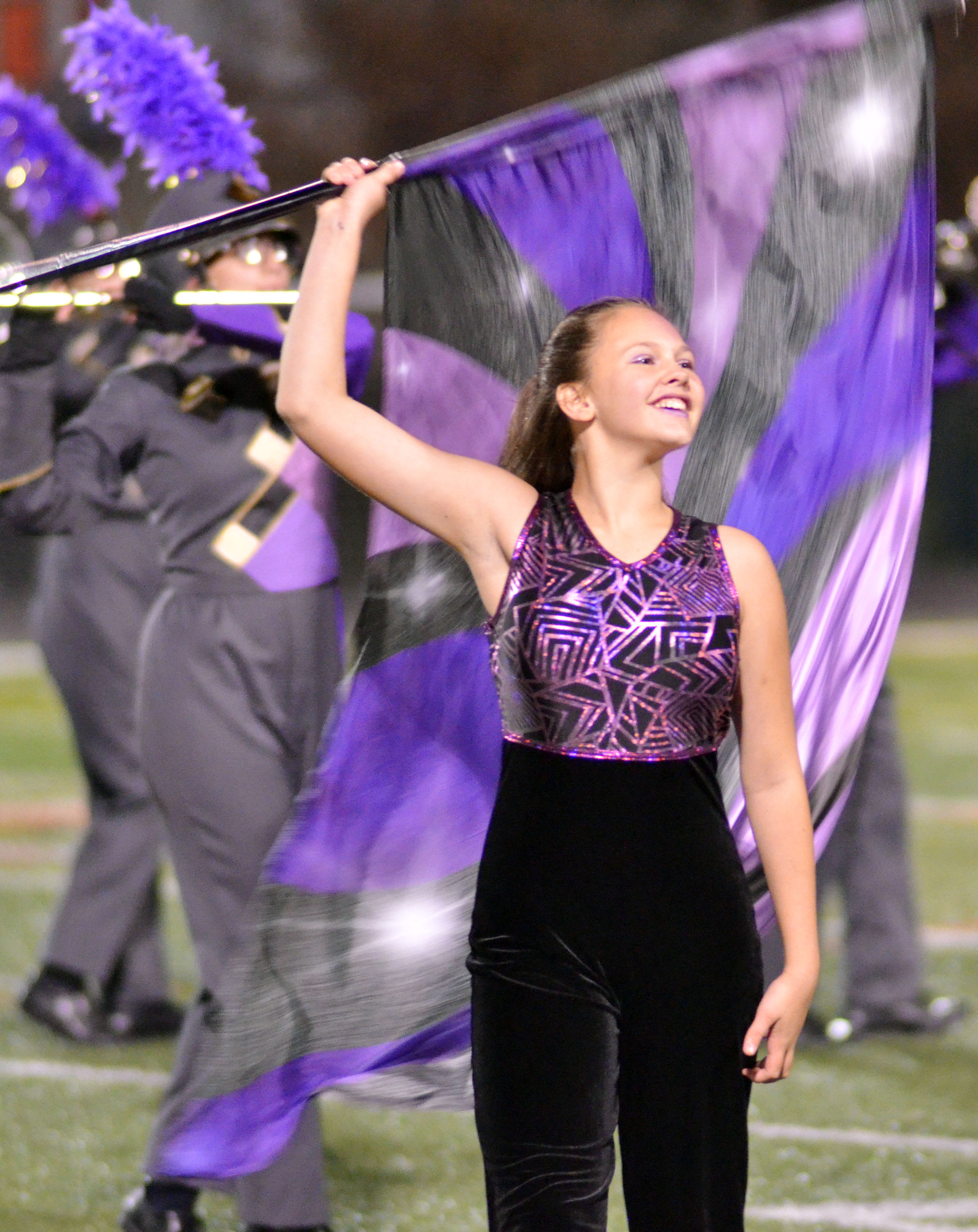 Campbellsville Middle School eighth-grader Mystique Jones performs with the color guard.