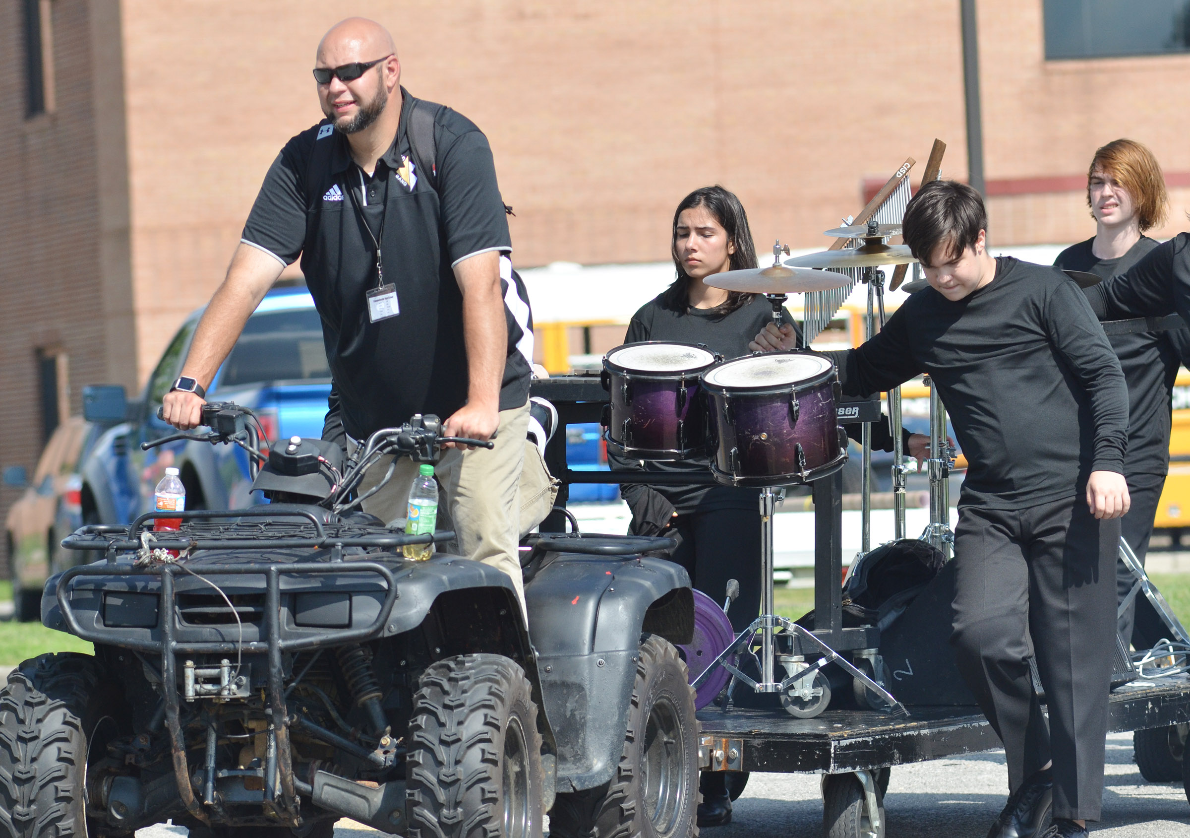 CHS band director Zach Shelton drives percussion players to warm up.