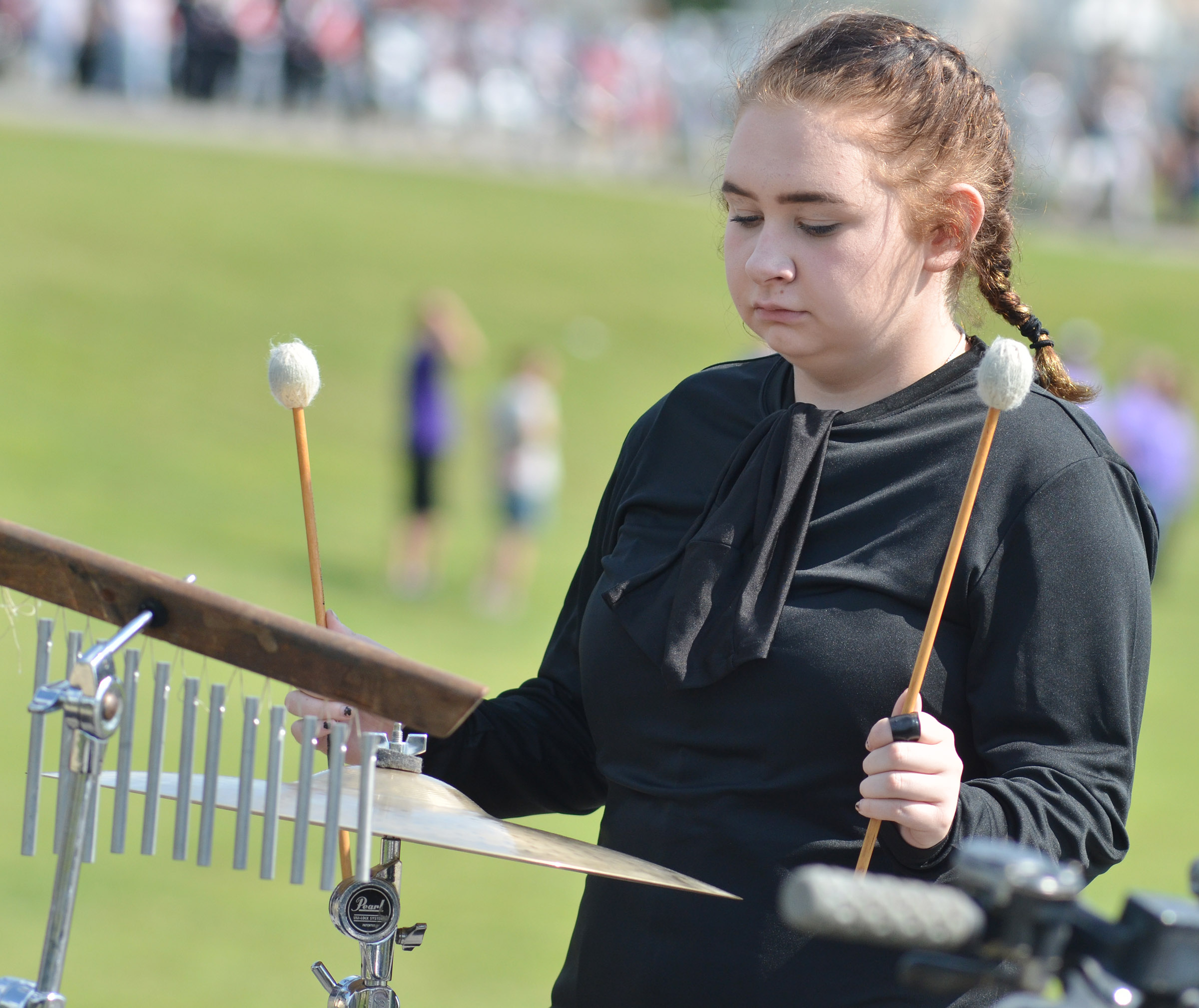 CHS junior Leslie McKenzie plays the cymbals.